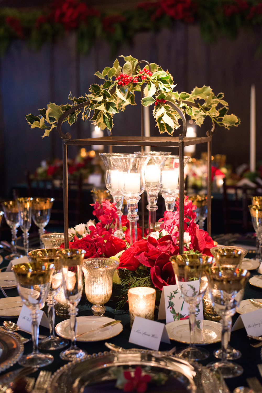 holly centerpieces red florals christmas themed wedding holiday season
