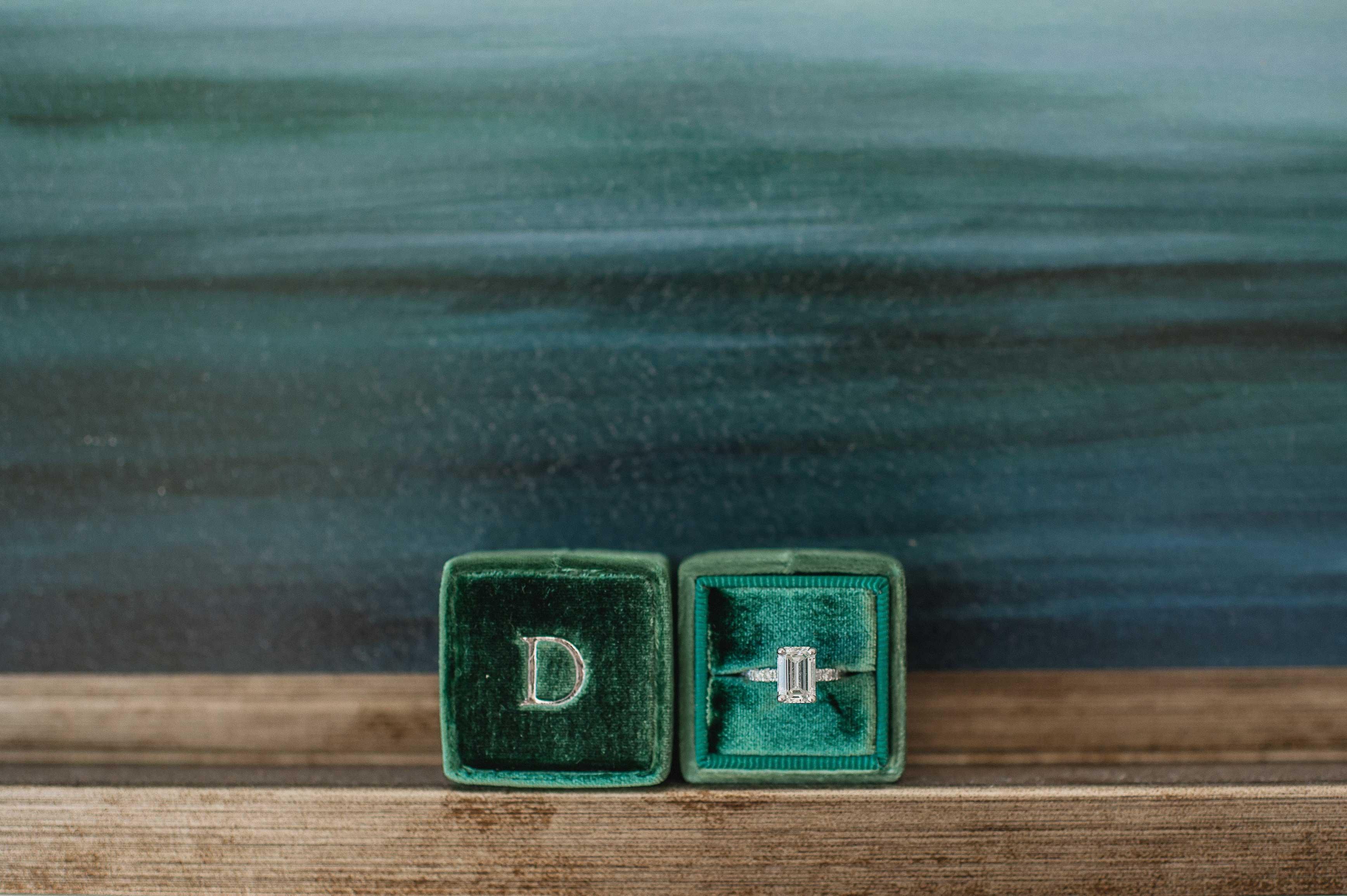 Emerald cut diamond engagement ring in velvet green The Mrs. Box