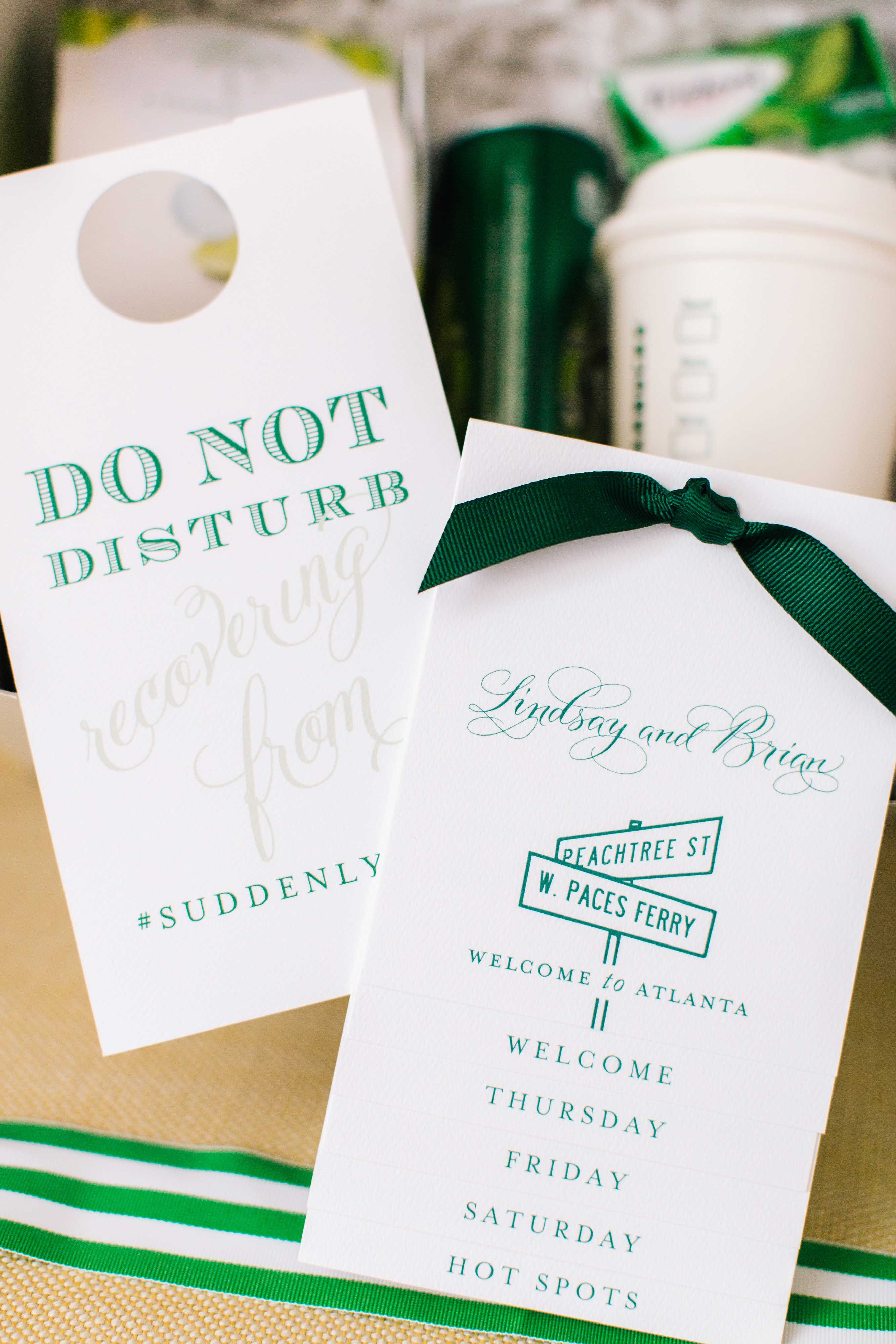 Green and white wedding paper goods itinerary welcome bag