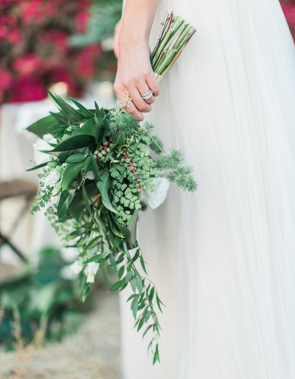 Bride holding greenery bouquet for wedding styled shoot
