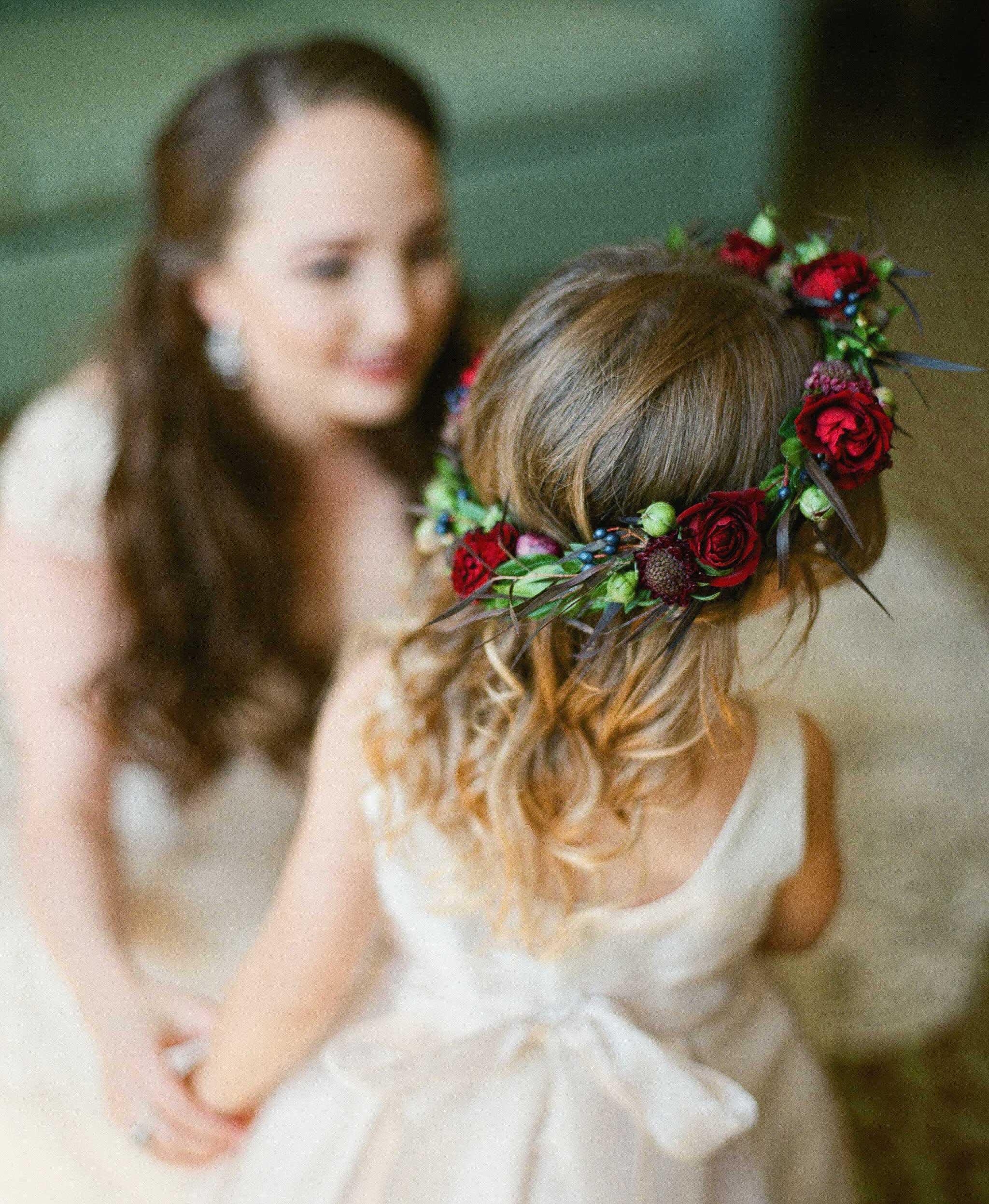 Flower girl with flower crown green leaves with burgundy red roses