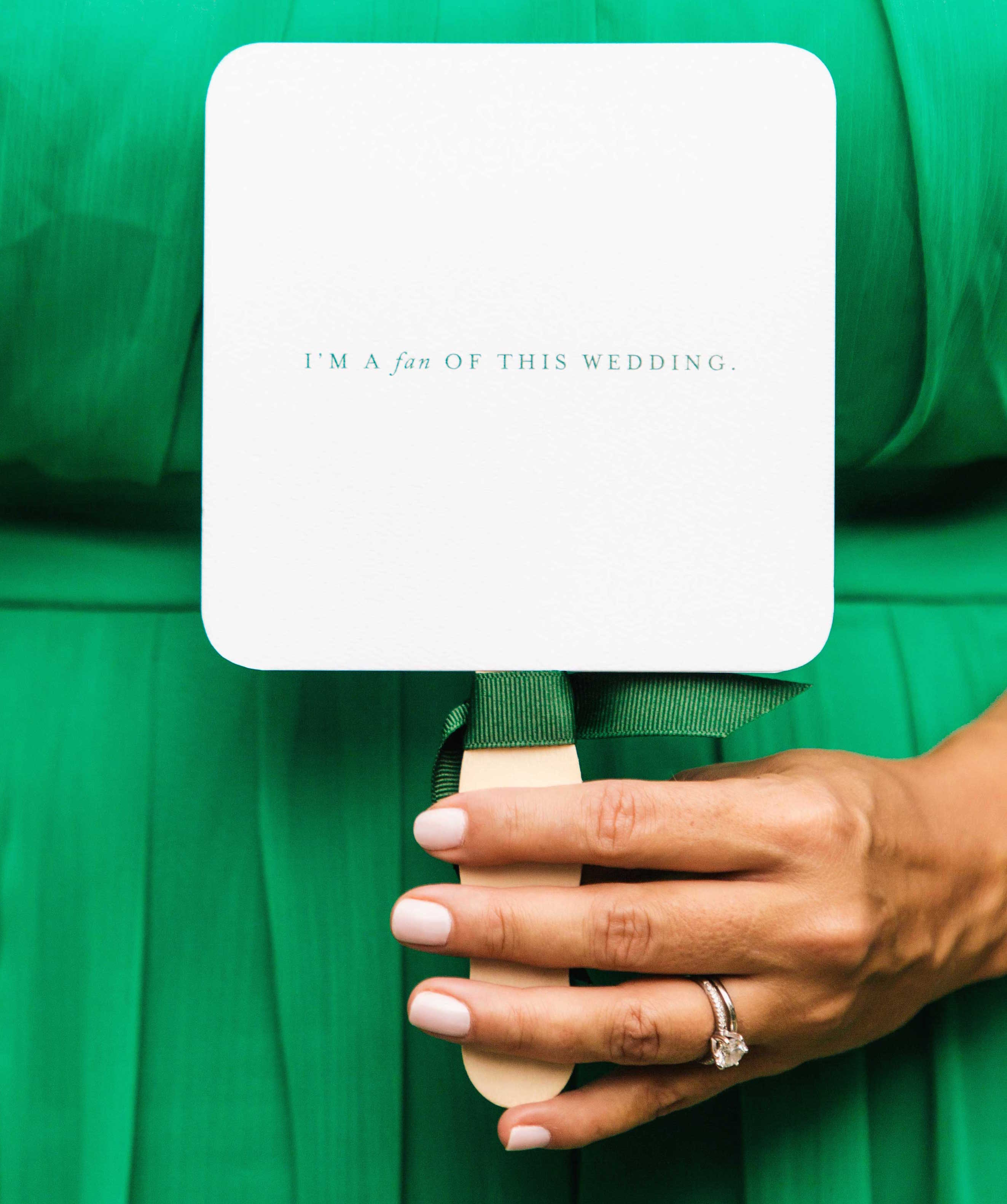 "Bridesmaid in dark emerald green dress holding wedding ceremony fan ""I'm a Fan of This Wedding"""