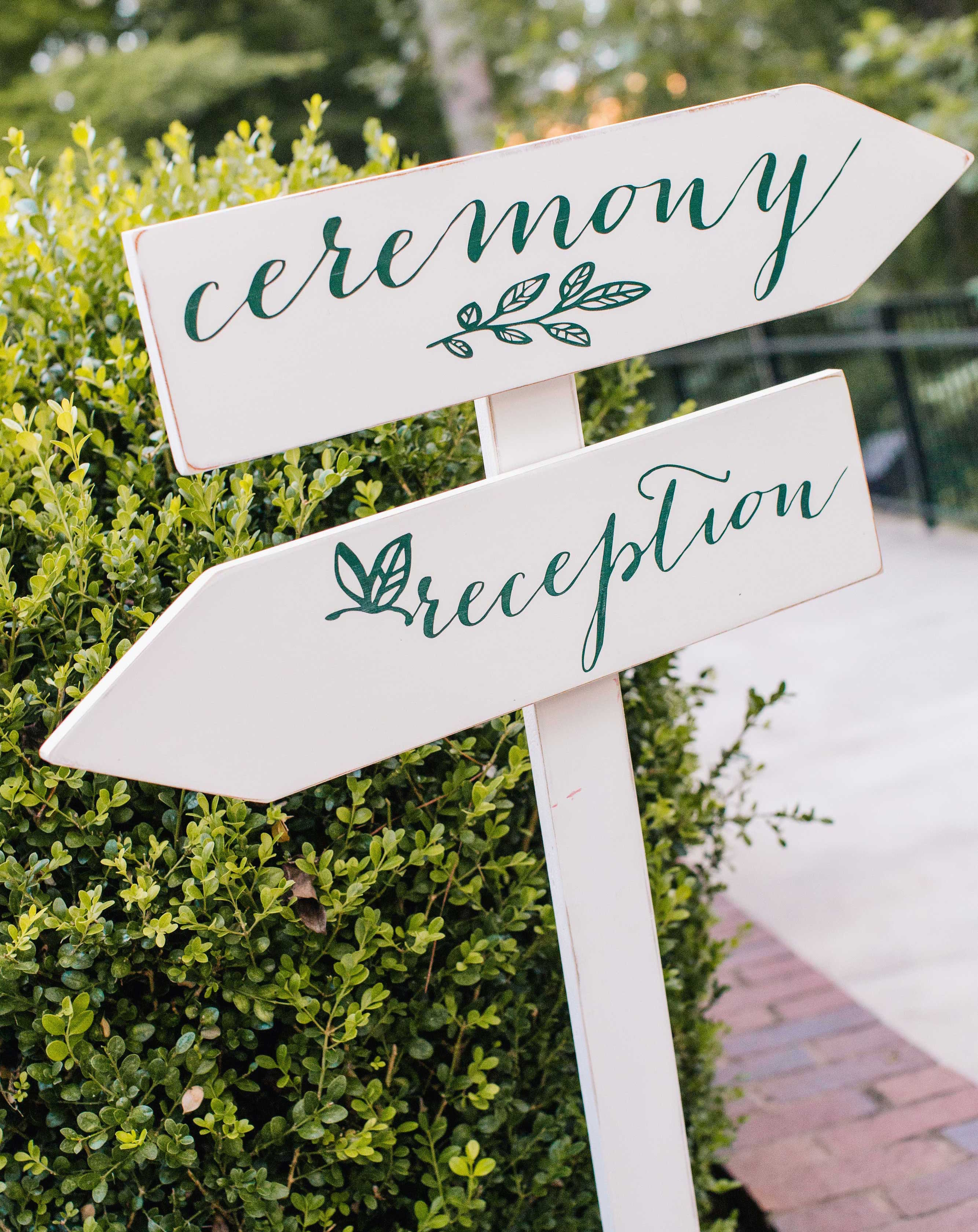 White directional sign arrow ceremony and reception dark green calligraphy wedding signage