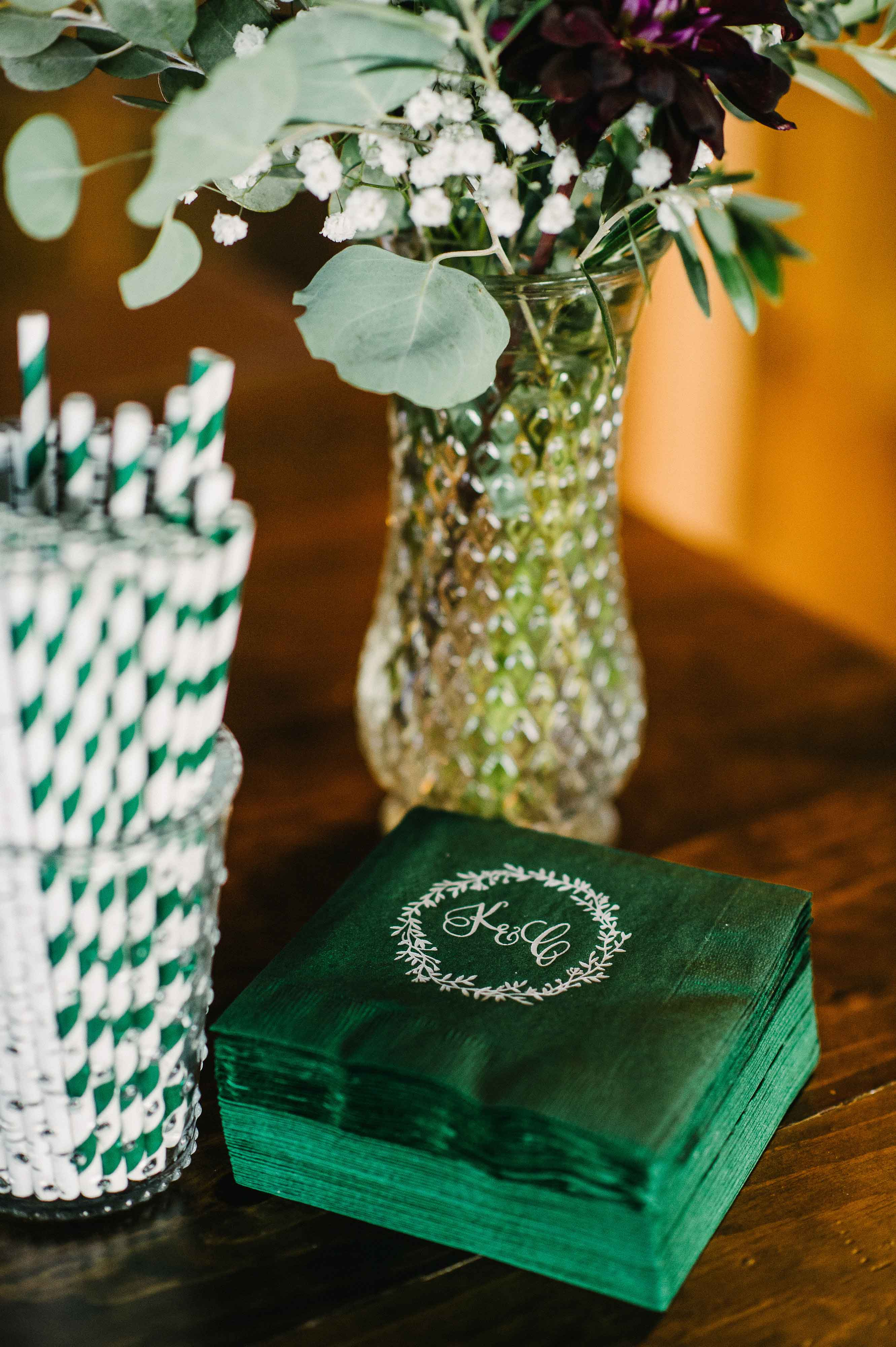 Dark green and white cocktail straws striped and napkins with monogram wedding