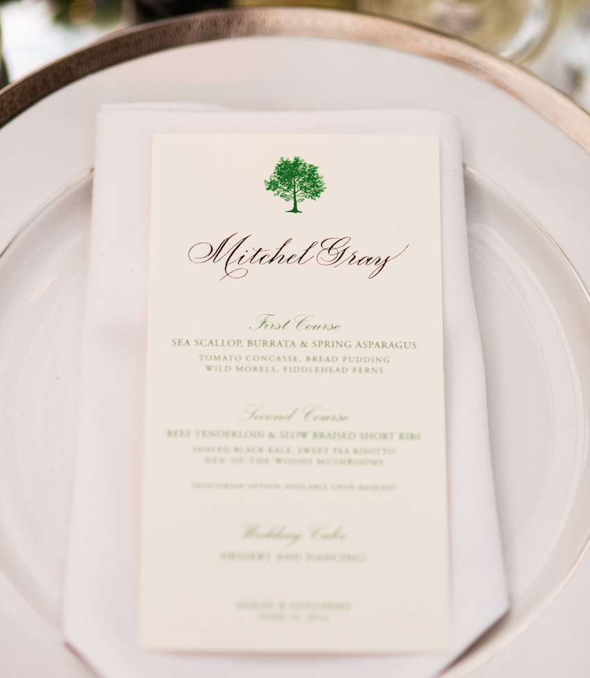 Green calligraphy script on menu with green tree design at top