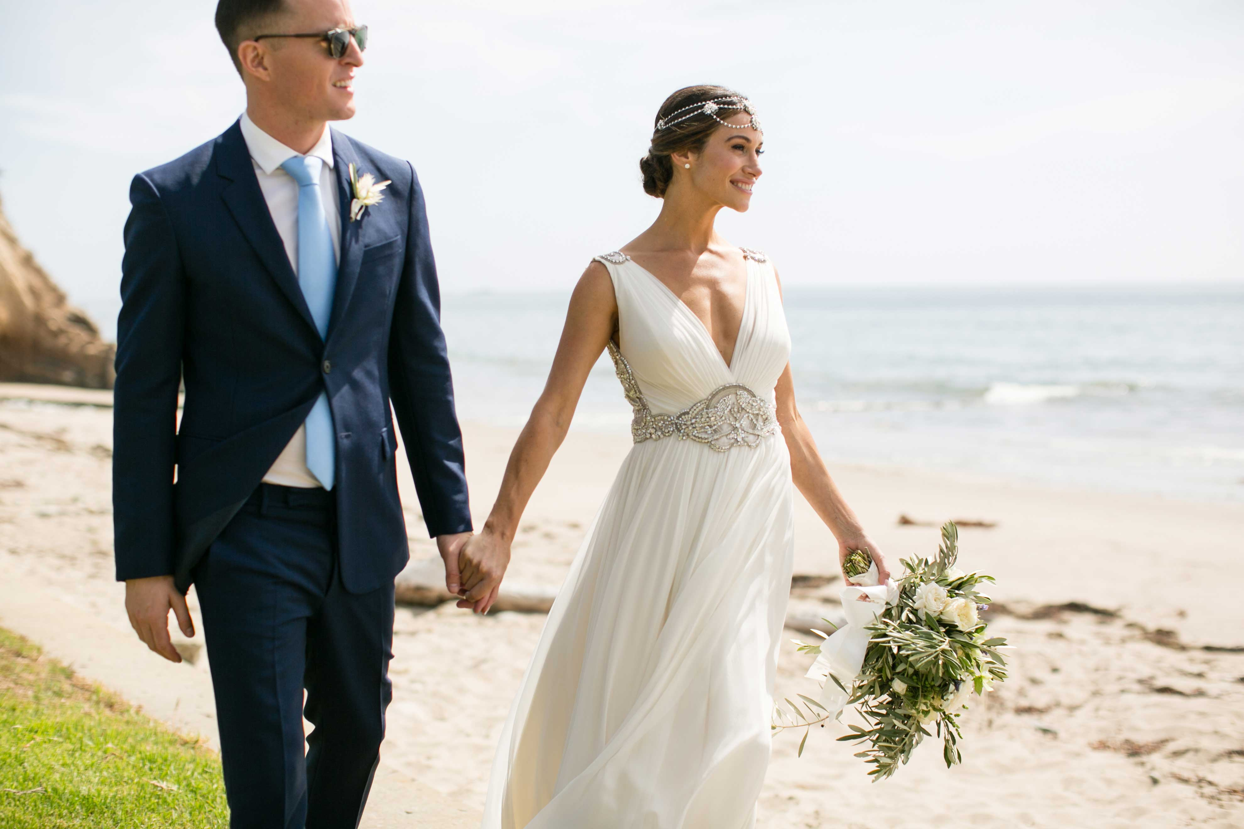 Inside Weddings fall 2016 bride in sheath dress with headpiece groom in navy blue suit