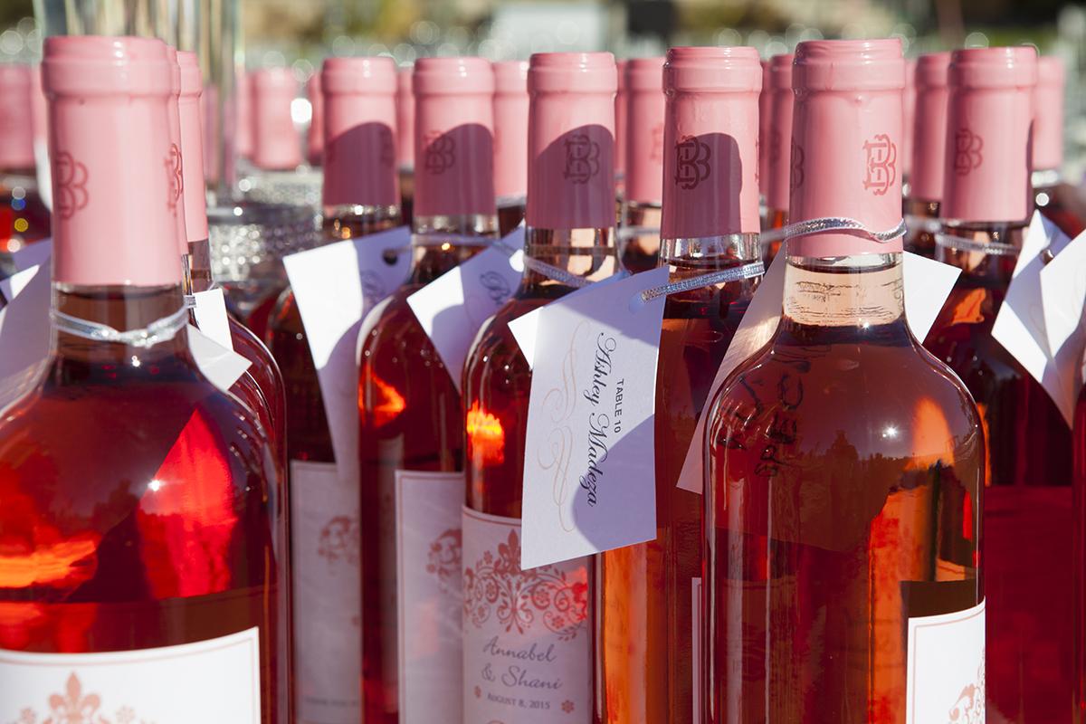 rosé wine as place cards wedding favors