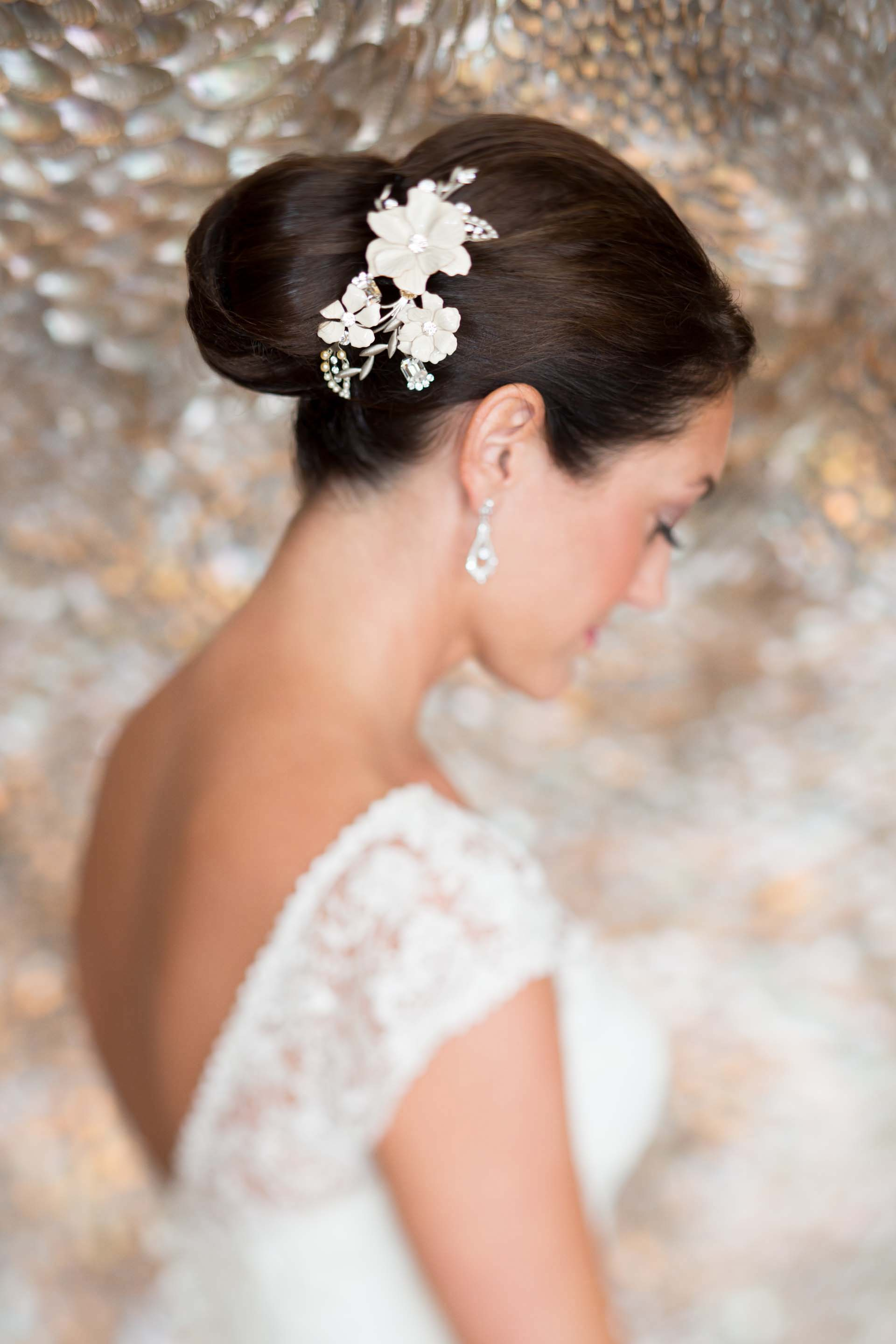 floral headpiece attached to side of bun, bridal headpiece