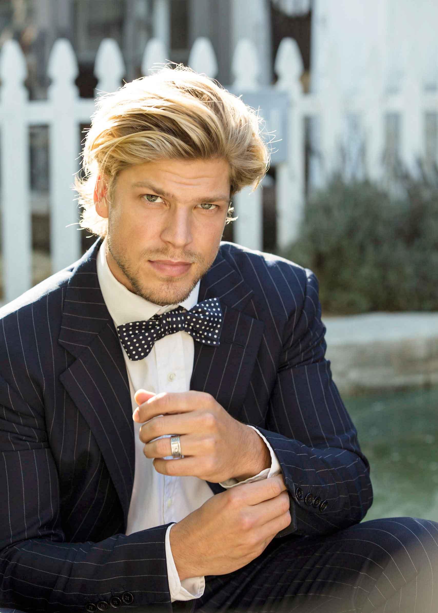 Groom in pin stripe Ralph Lauren suit with bow tie