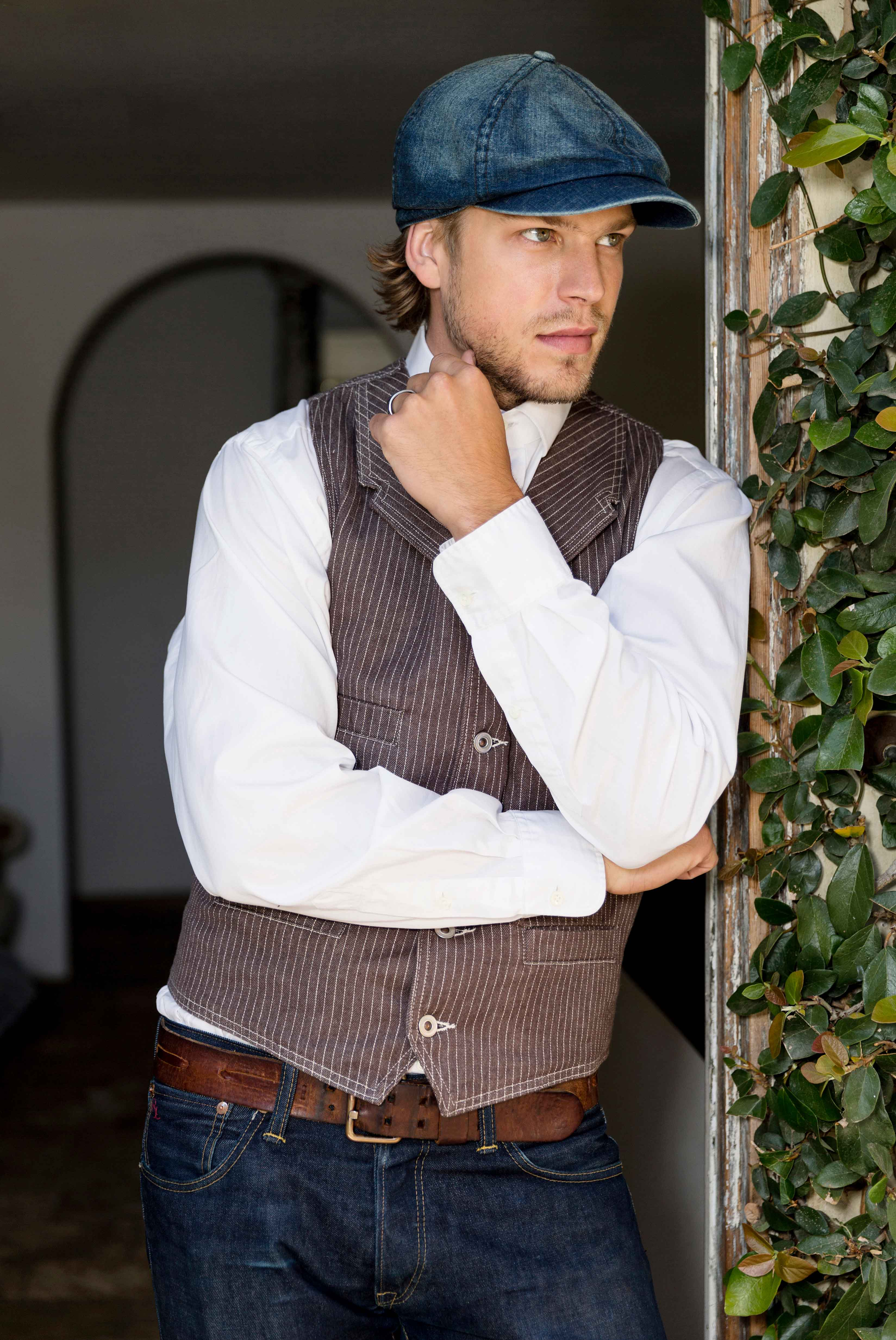 Groom in Stronghold vest with blue denim hat Ralph Lauren inspired styled shoot