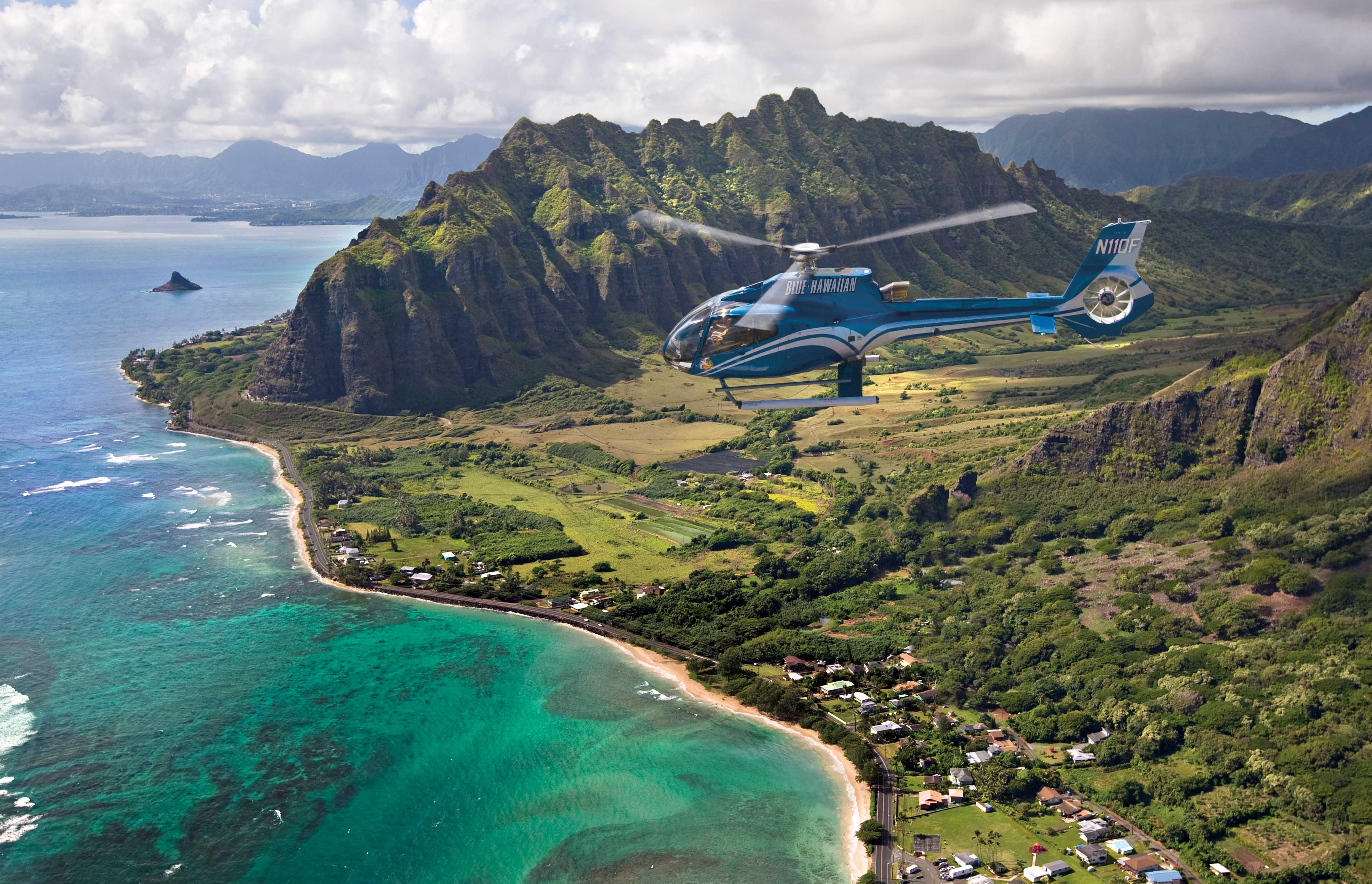 View of Kualoa in Oahu, Hawaii - Helicopter Tour Harry Winston Proposal Package Montage Kapalua Bay