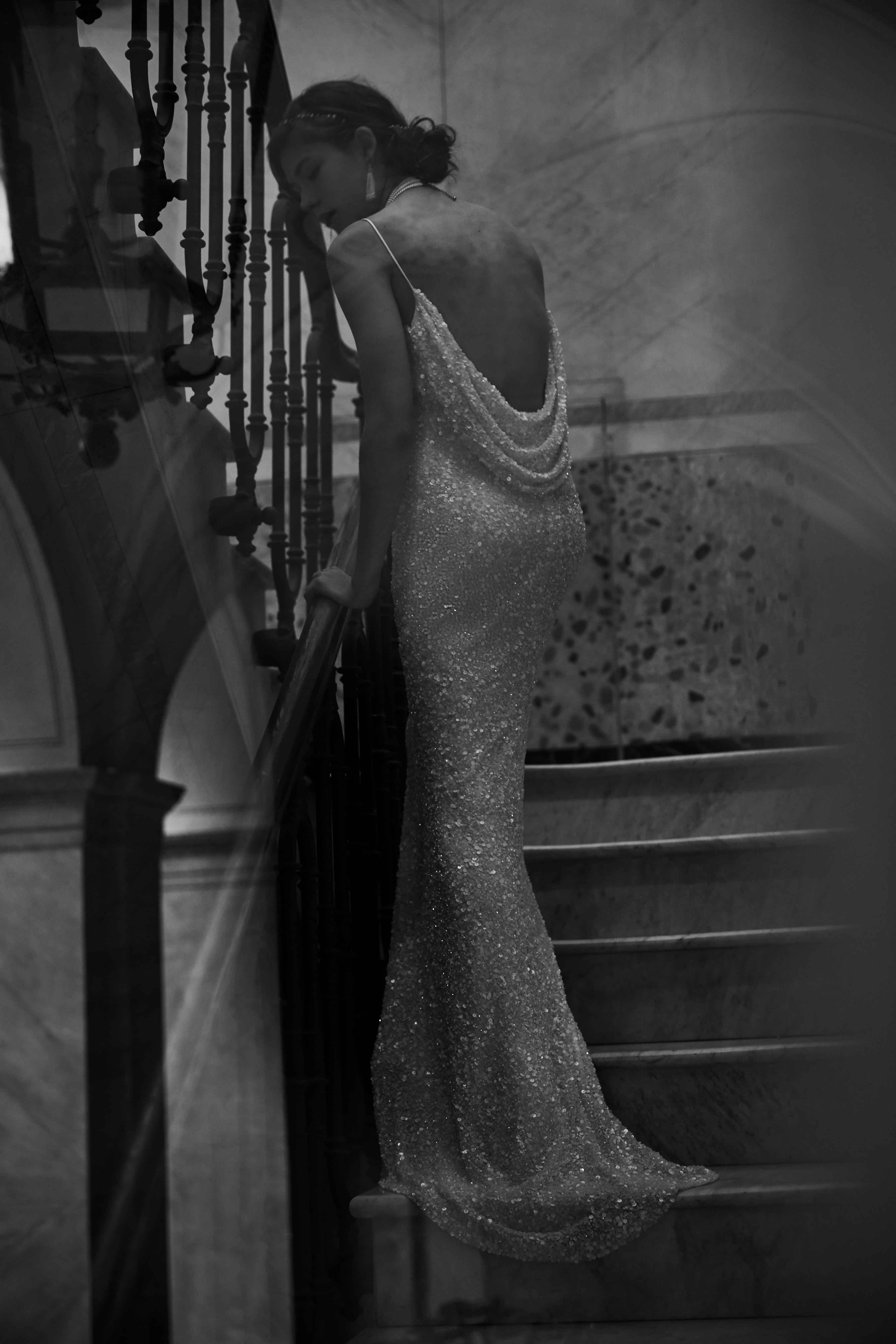 Black and white photo of sparkling cowl back wedding dress BHLDN Natalia gown