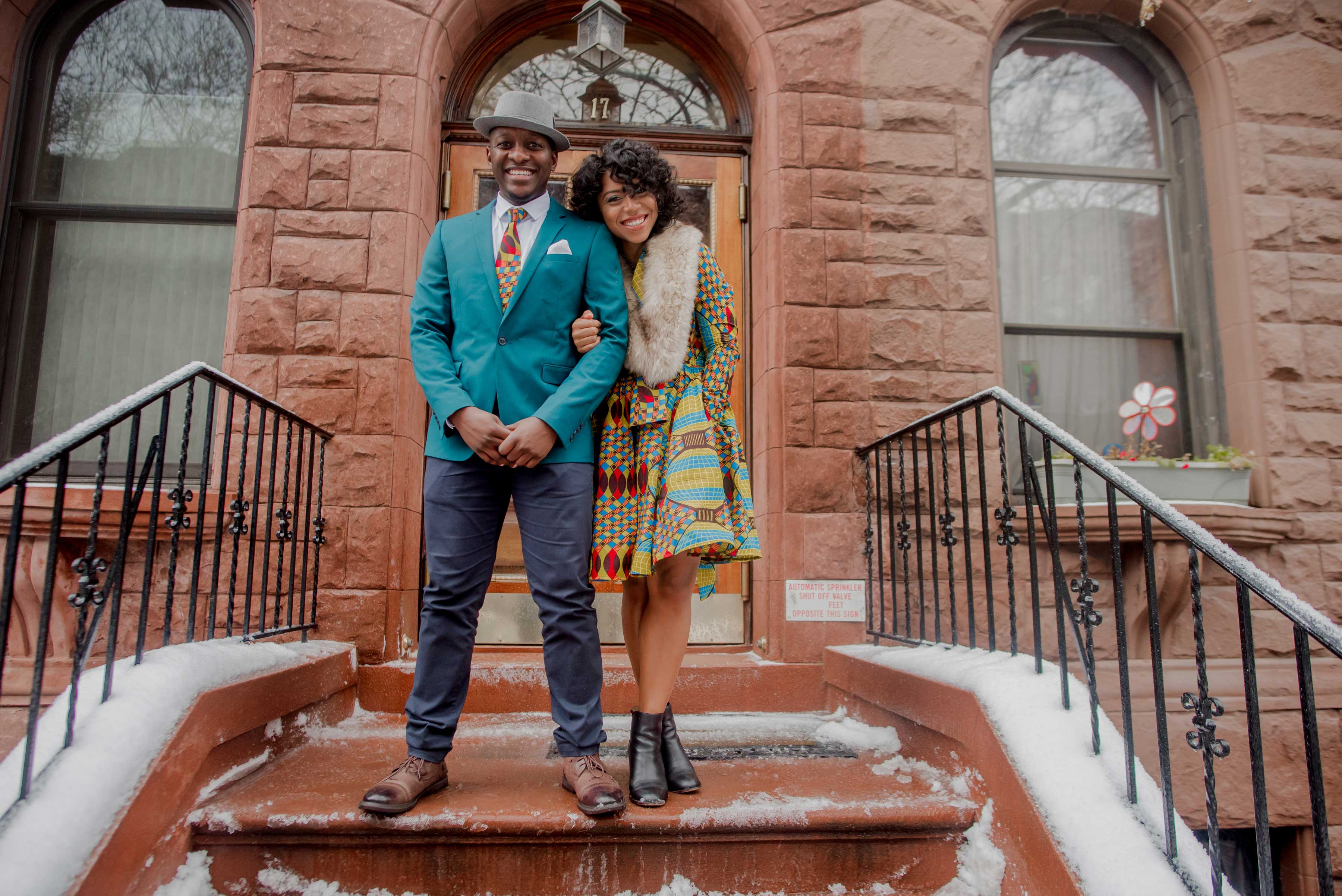 New York City engagement session photos engaged couple smiling New York City brownstone
