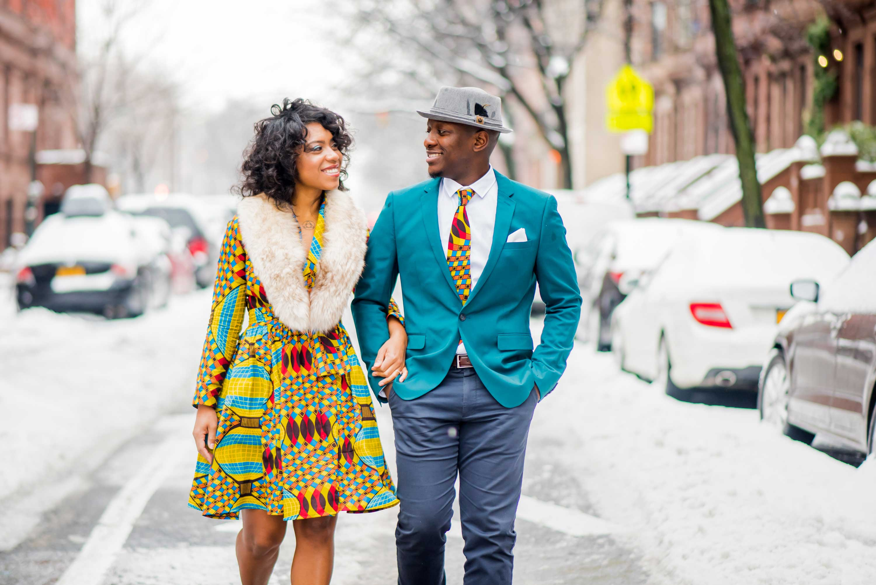 Colorful engagement shoot outfits in New York City neighborhood snow