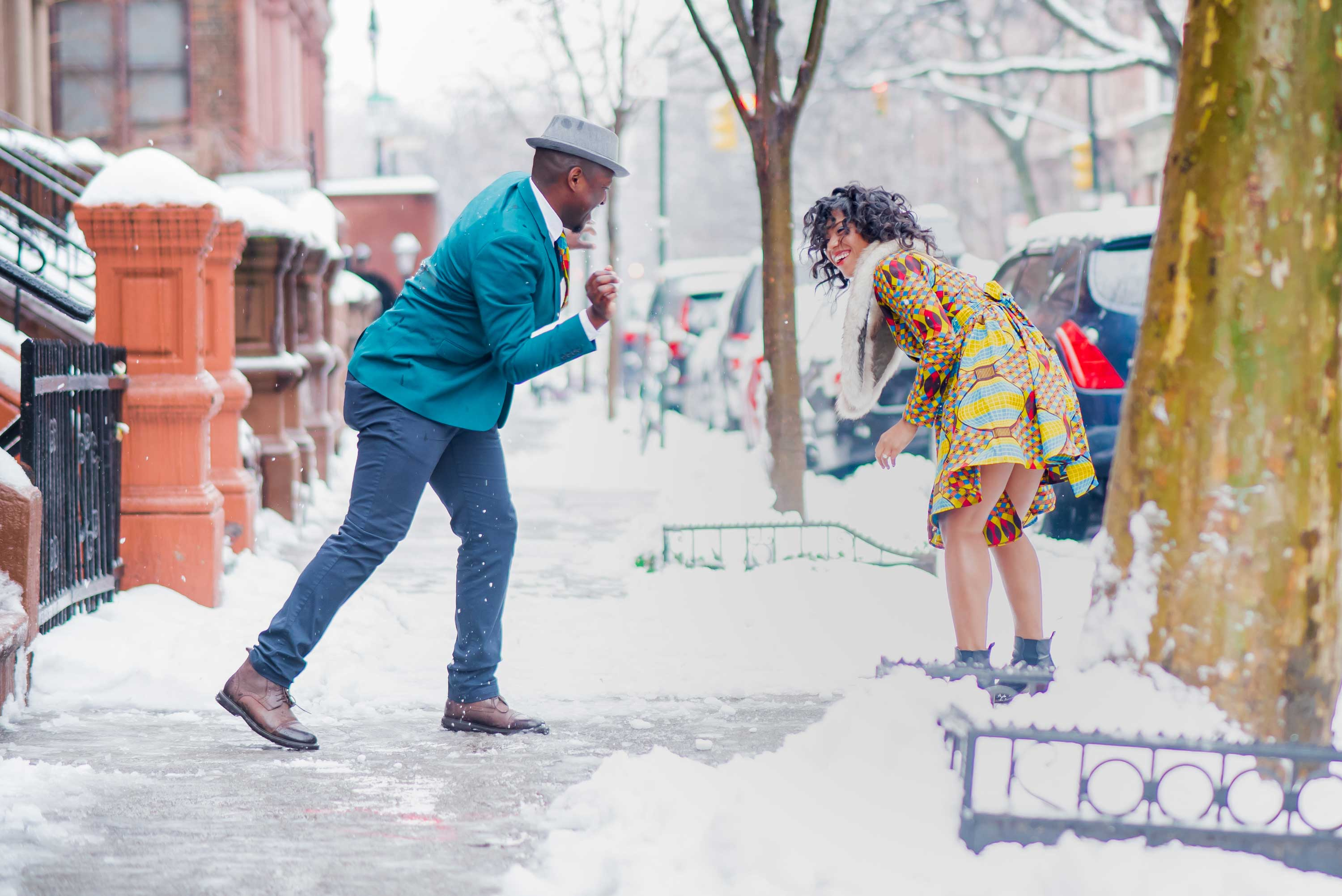 Bride laughing during snowball fight New york City harlem snowy day photo shoot