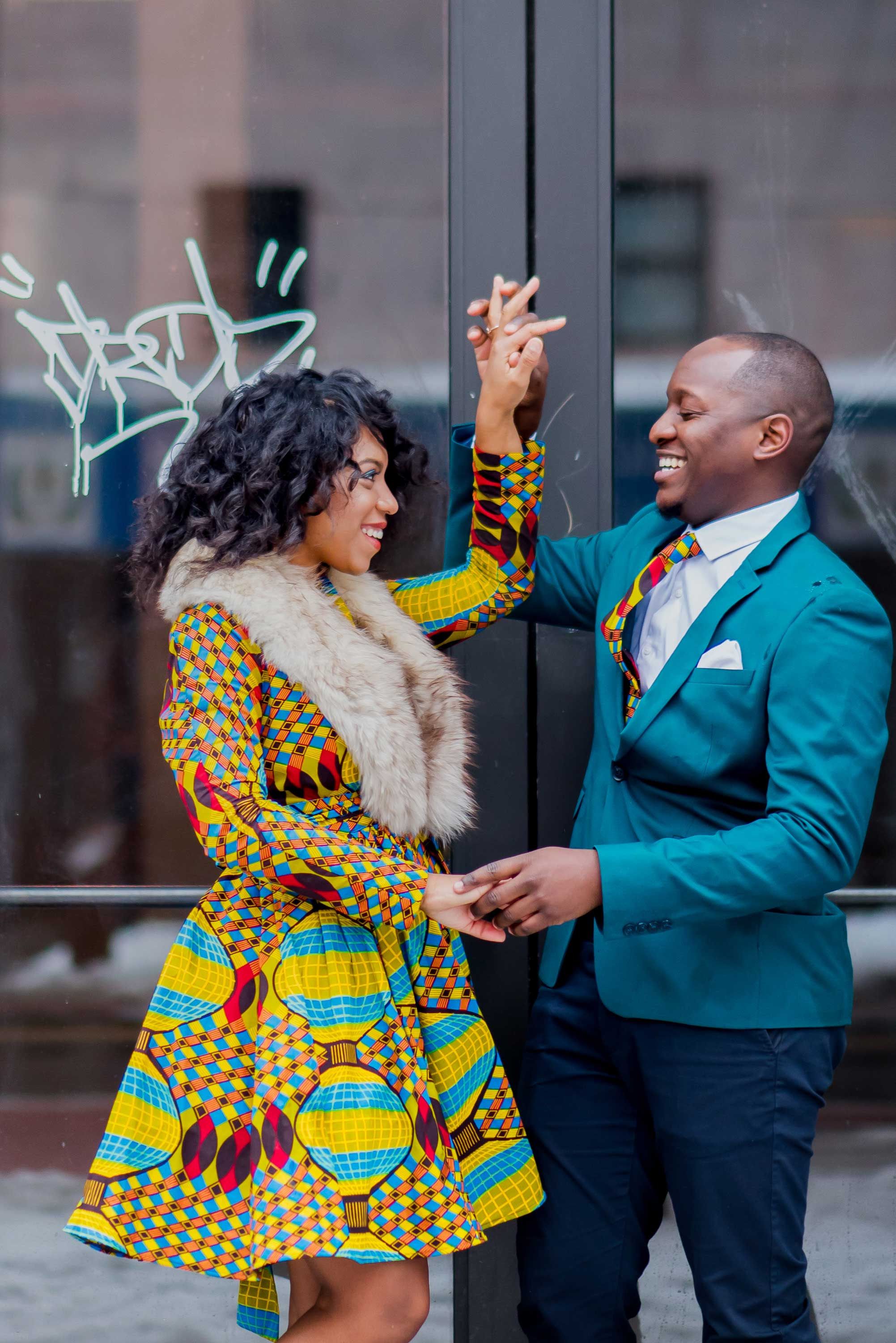 Bride and groom to be hold hands engaged photo session engagement shoot new york city graffiti door