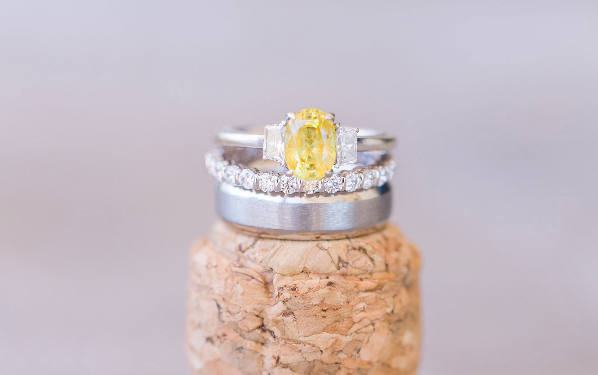 oval yellow diamond engagement ring with diamond side stones, white gold band