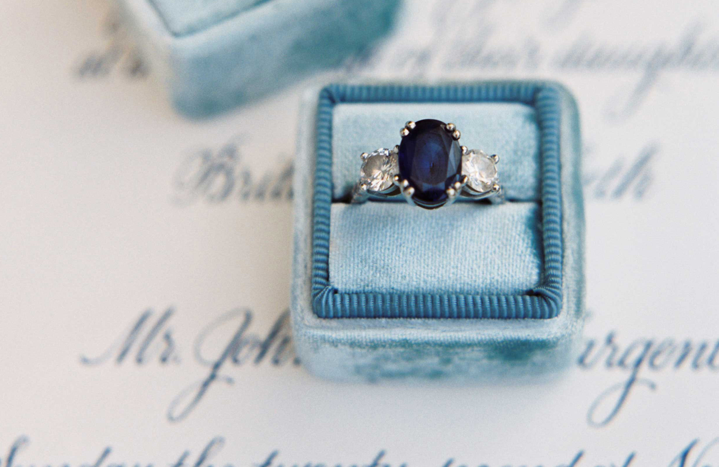 oval sapphire engagement ring, diamond side stones, white gold