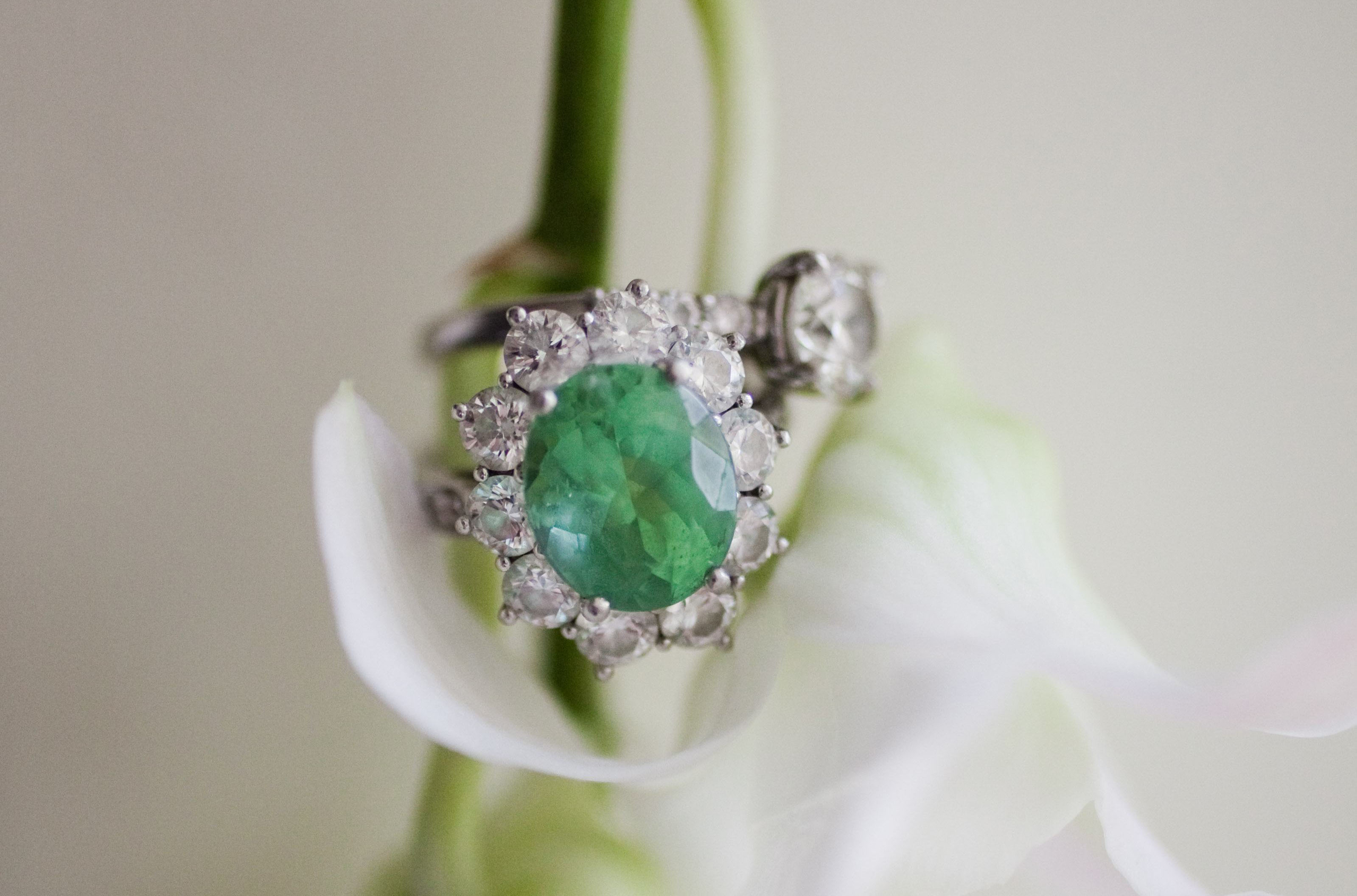 oval emerald engagement ring starburst halo, white gold