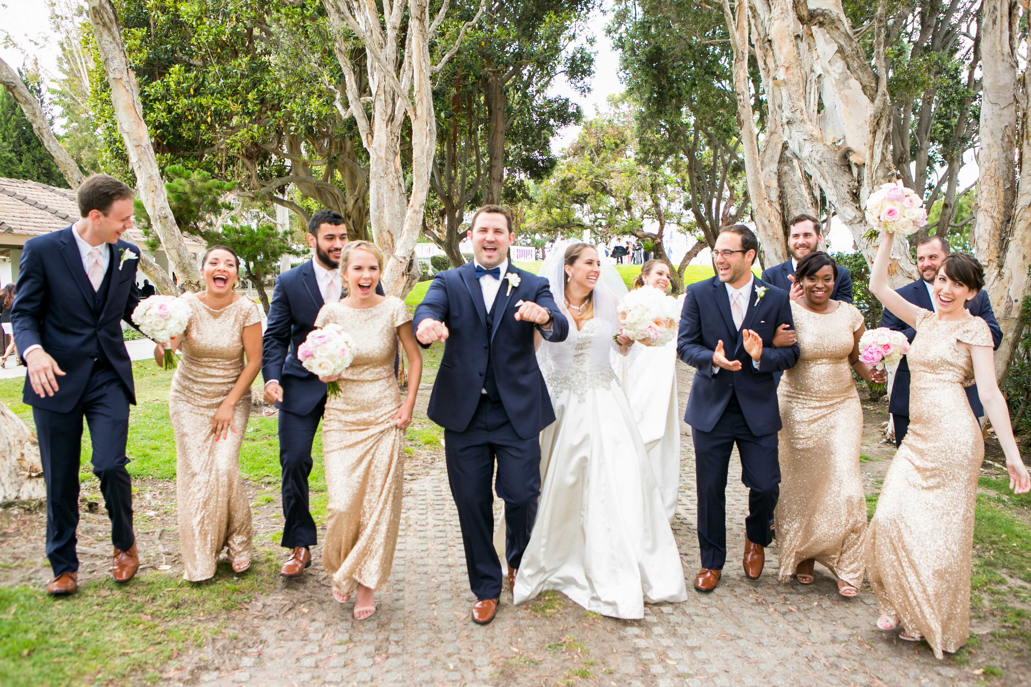 wedding party with bridesmaids and groomsmen alternating, walk and laugh