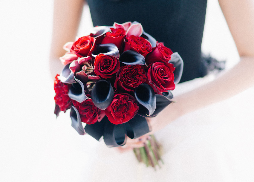 dark bridal bouquet with red roses and black calla lilies
