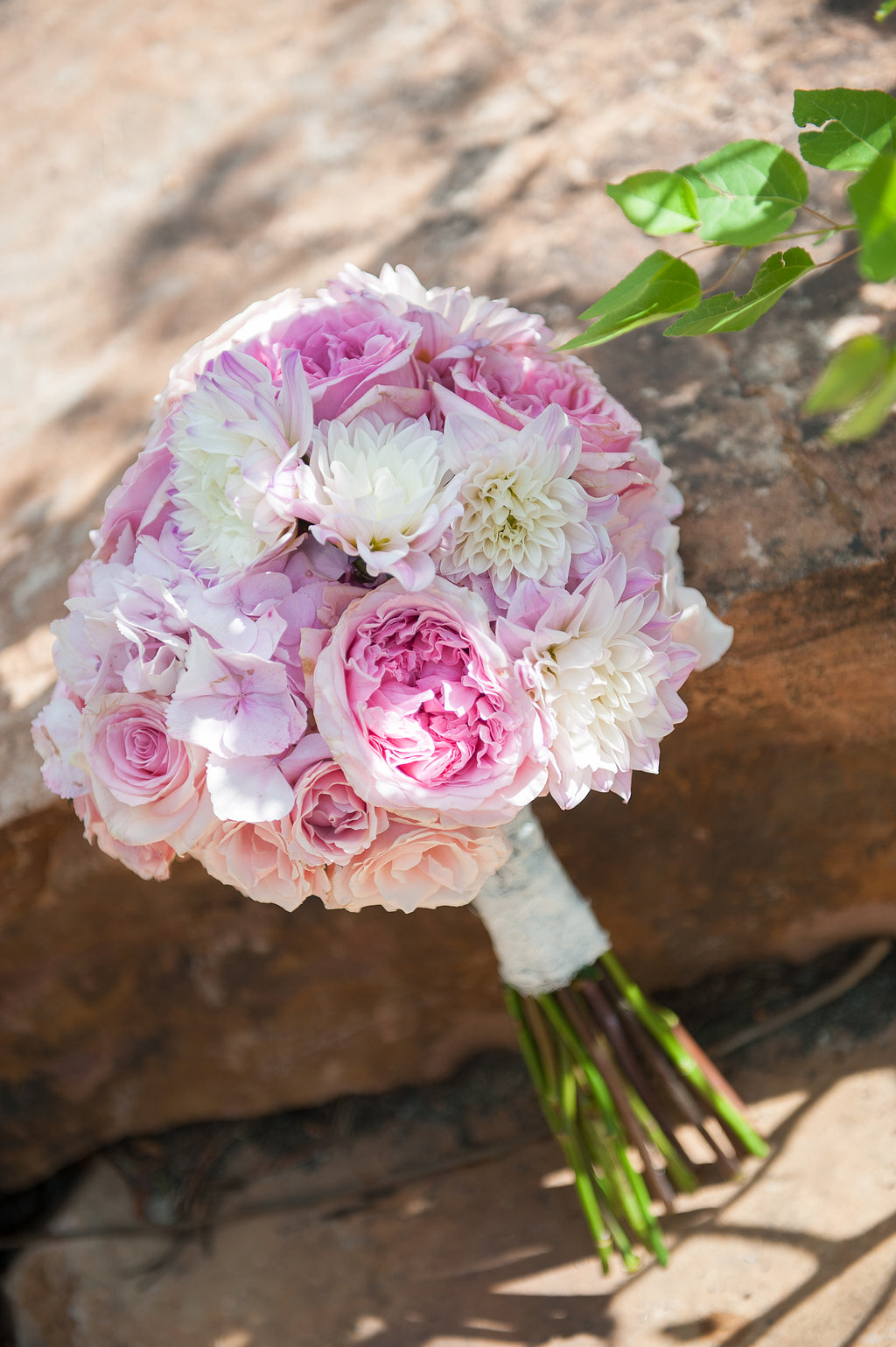 white, peach, and pink bridal bouquet with dahlias and garden roses