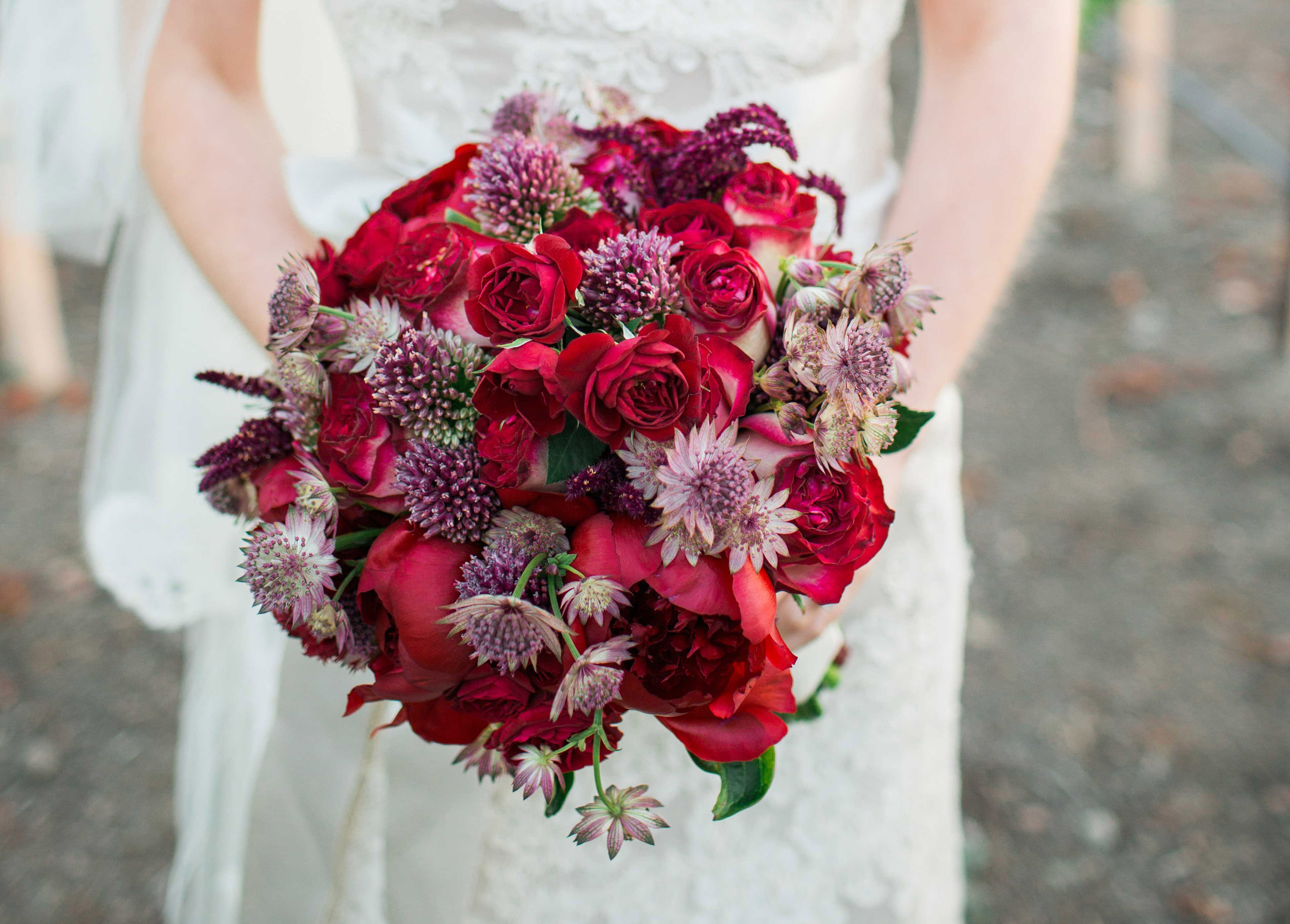 red roses purple thistle bridal bouquet