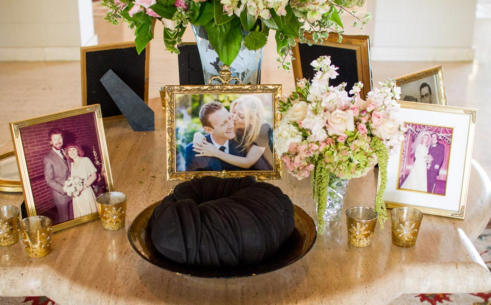 Wedding ceremony Jewish yarmulke table with family photos in frames