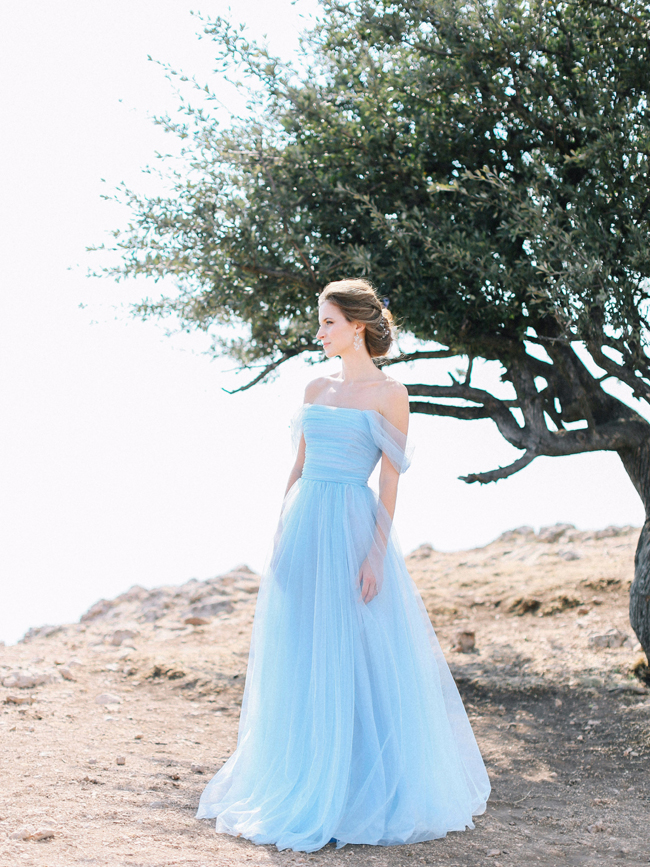 Bride in pretty light blue off the shoulder romantic wedding dress elopement