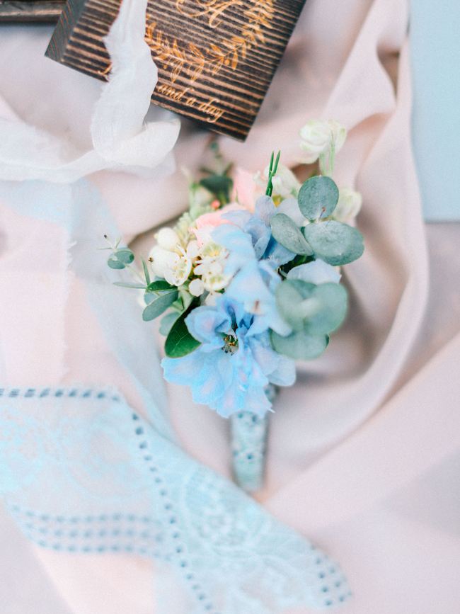 light blue boutonniere with greenery for elopement