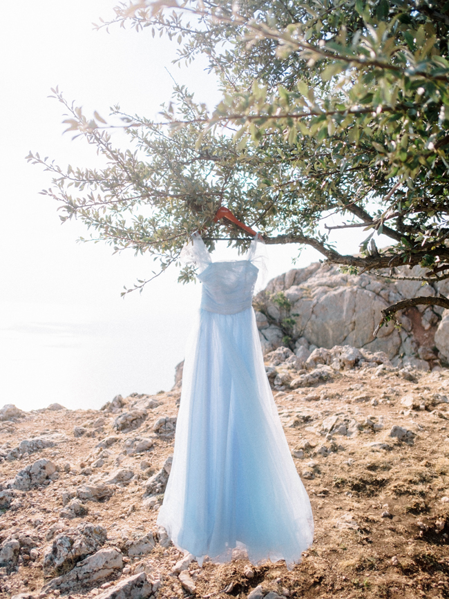 Light blue powder blue off the shoulder dress hanging wedding elopement