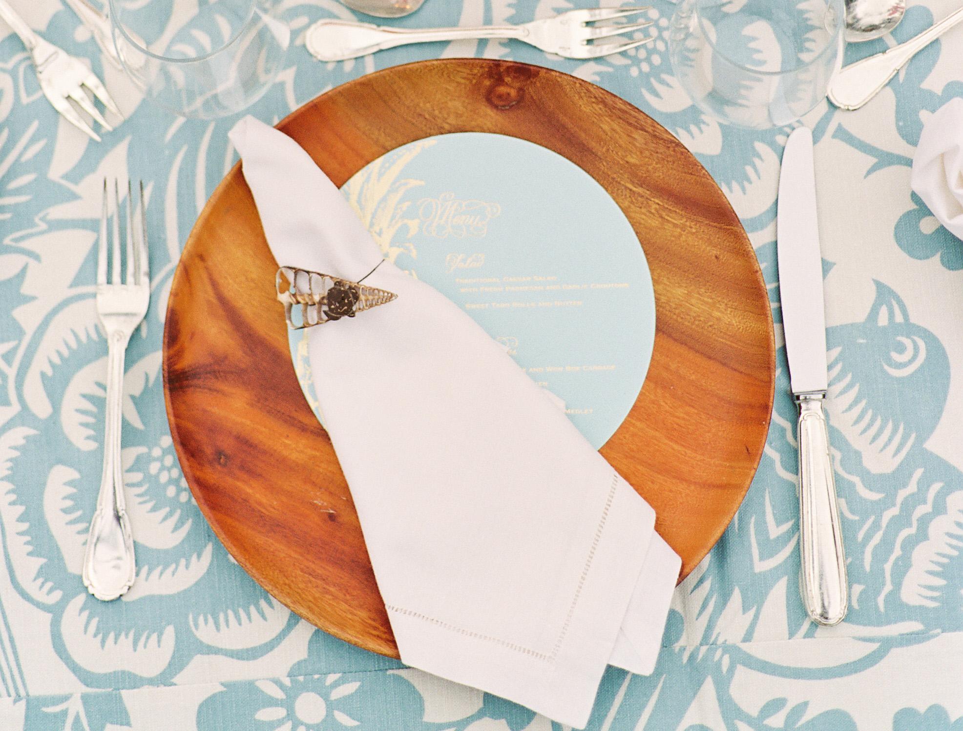 hawaiian wedding decor, wooden charger, sky blue patterned linens