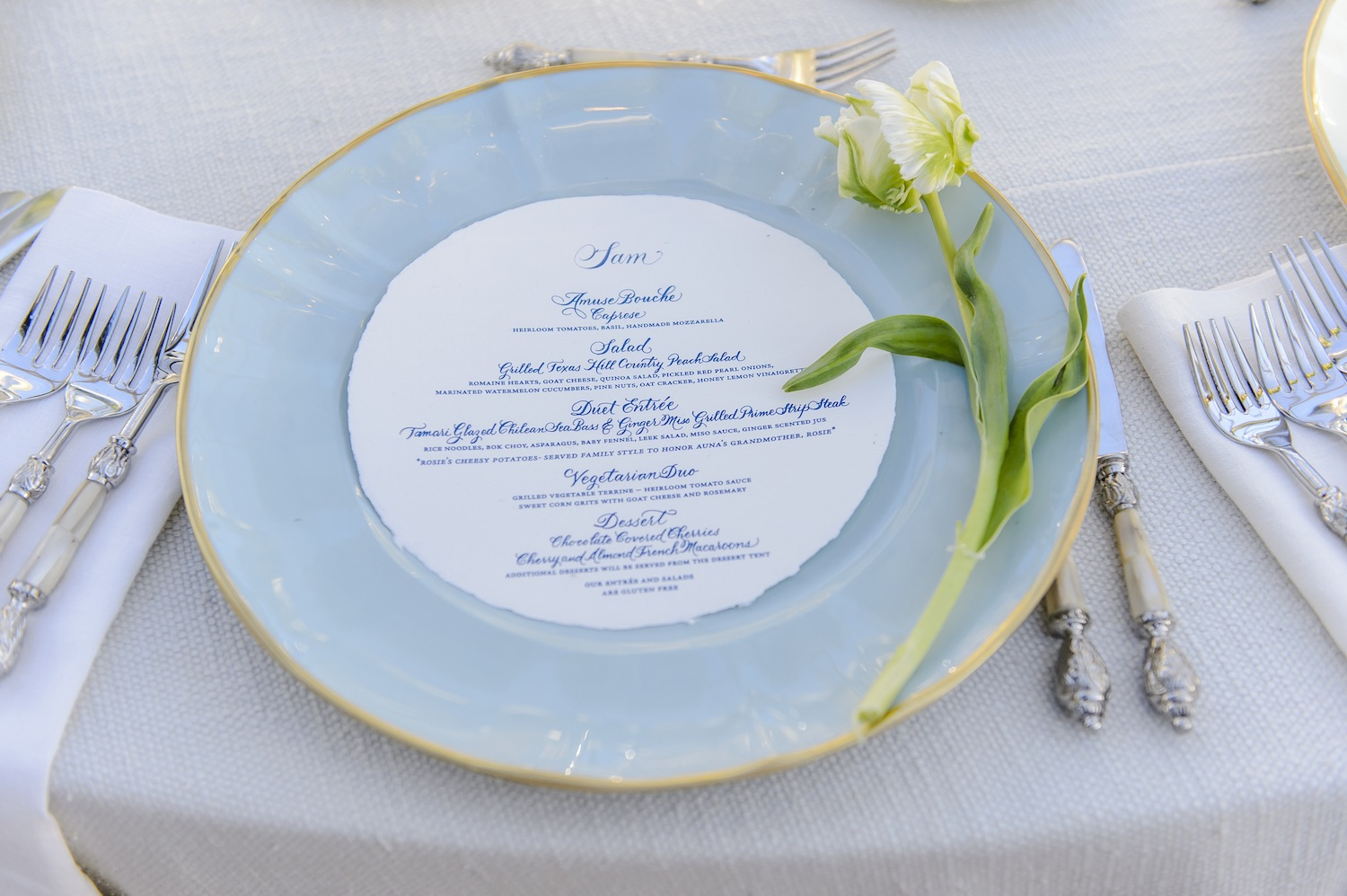 light blue fine china charger plate with gold trim for wedding reception place setting & 11 Chargers that Transformed Place Settings - Inside Weddings