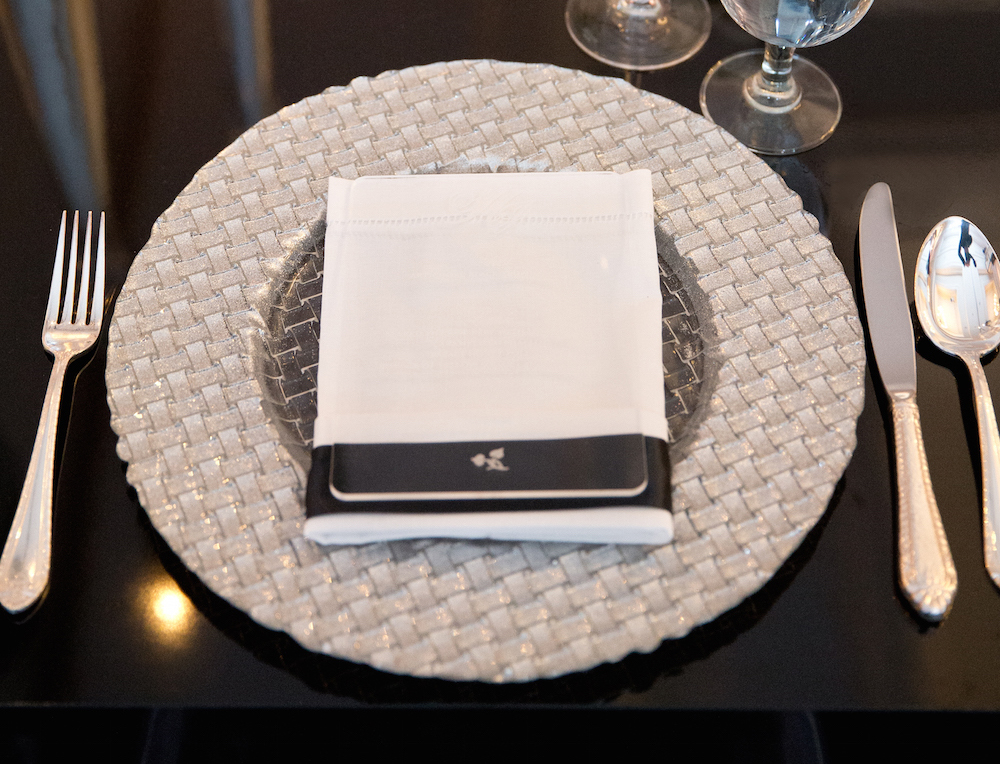 silver weaved charger plate for opulent wedding reception place setting