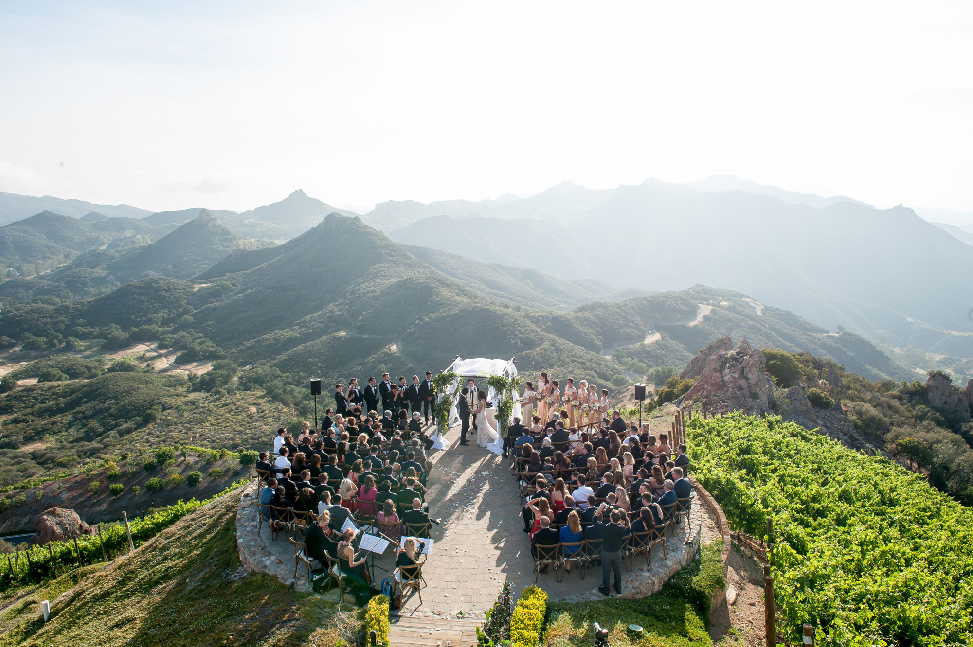 Inside Weddings Spring 2017 issue Malibu wedding ceremony beautiful view on cliff overlooking canyon