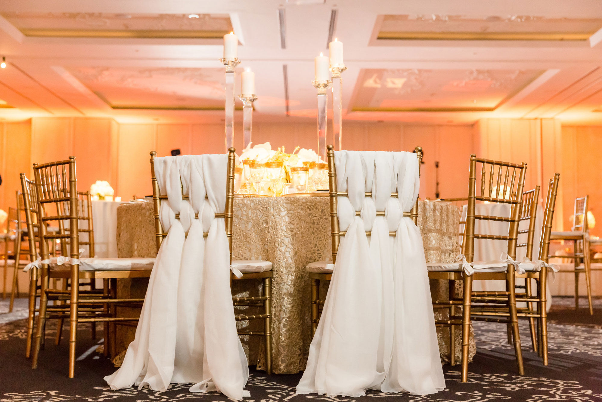 Inside Weddings Spring 2017 issue nuage designs linens weaved through chair back wedding reception