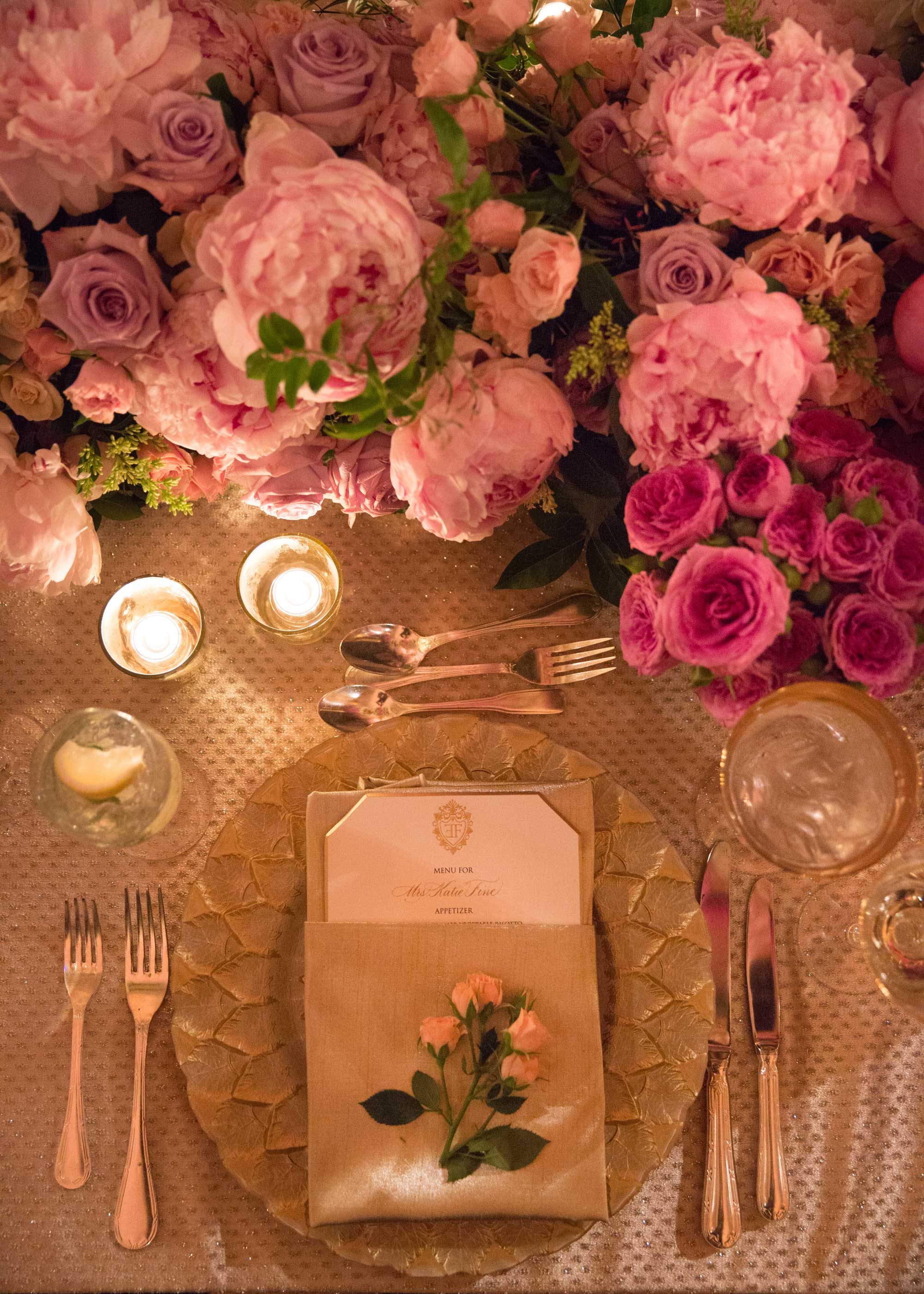 Inside Weddings Spring 2017 issue place setting at wedding nuage designs linens and bright pink flowers