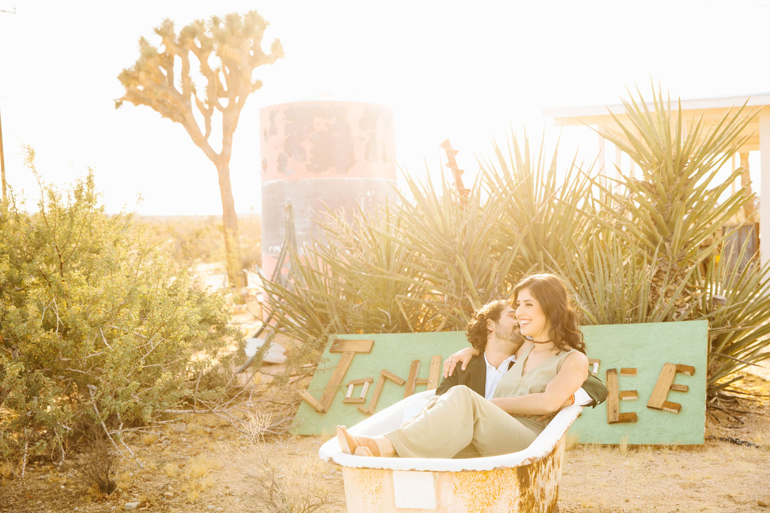 Bride and groom in antique vintage bath tub in Joshua Tree engagement shoot ideas