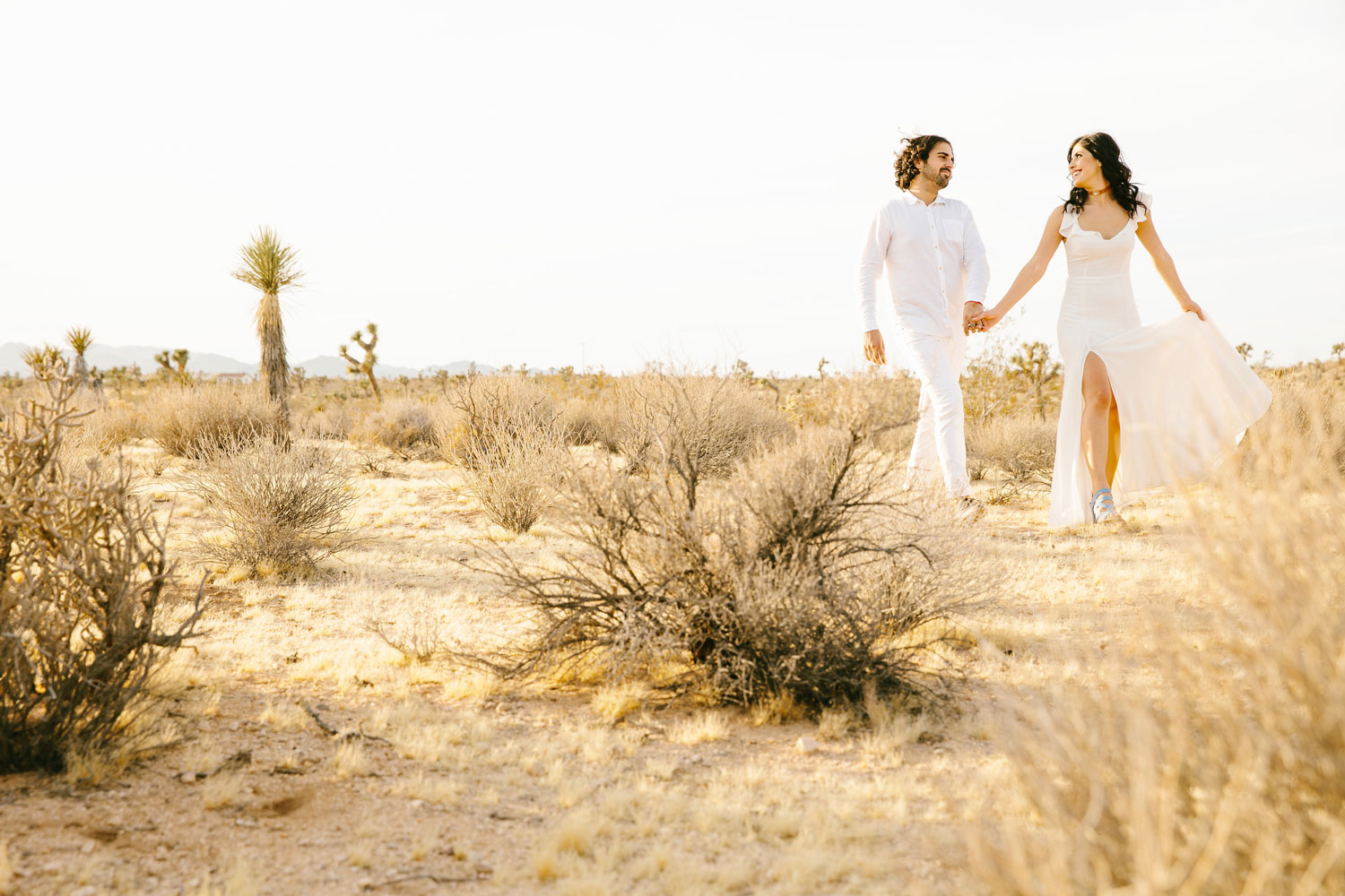 Desert engagement shoot ideas Joshua Tree all white outfits