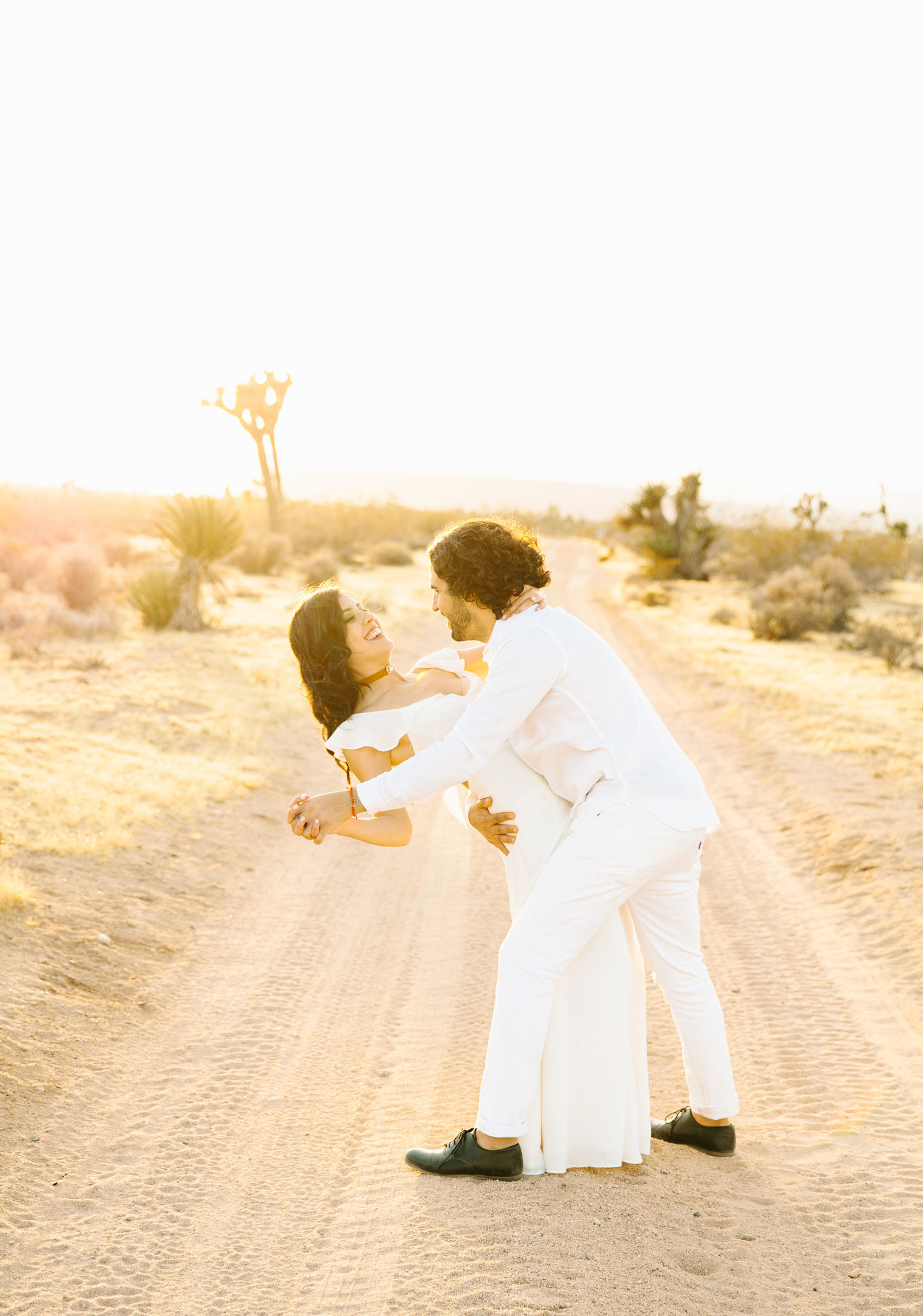 Bride and groom dancing in the desert Joshua Tree engagement shoot ideas