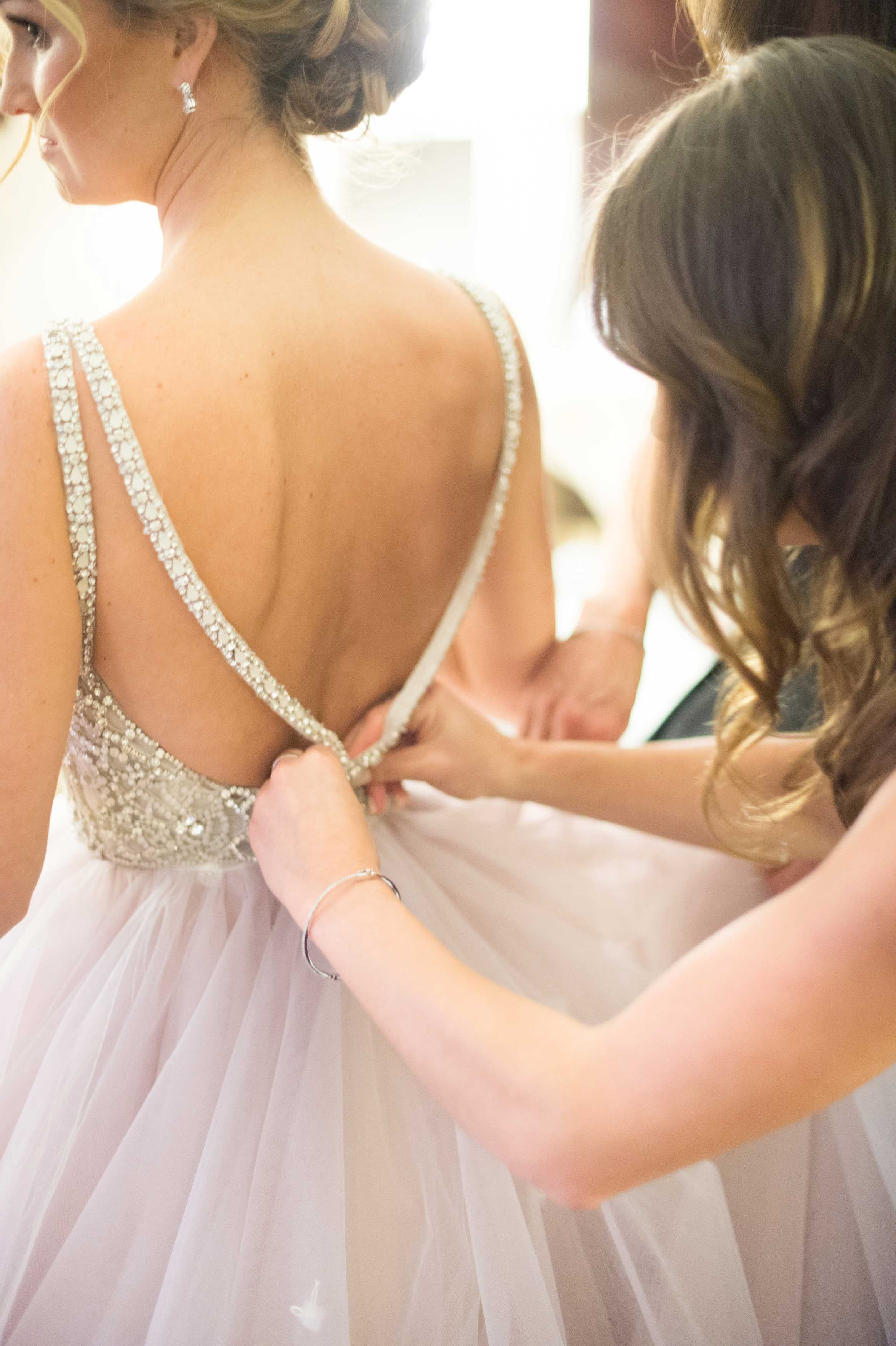 maid of honattaches sparkly strap of hayley paige wedding dress beaded bodice with lilac tulle skirt