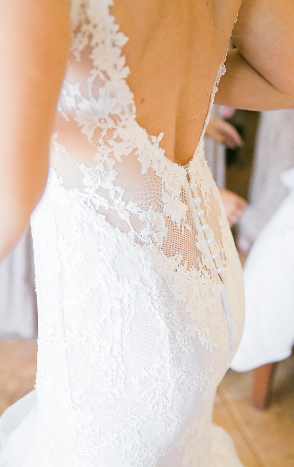 detail shot of lace berta bridal wedding gown with low back