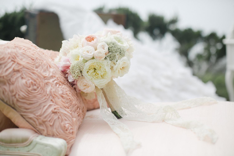 Katrina Hodgson tone it up wedding in Malibu bouquet with lace ribbon