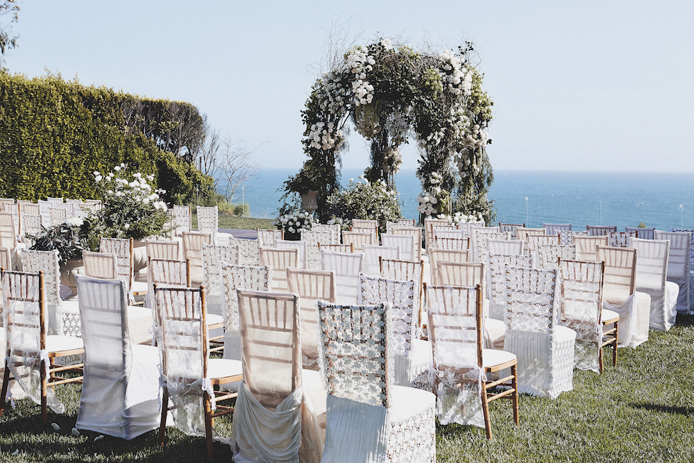 Brittany Palmer and Aaron Zalewski oceanfront ceremony lace wedding chairs outdoor
