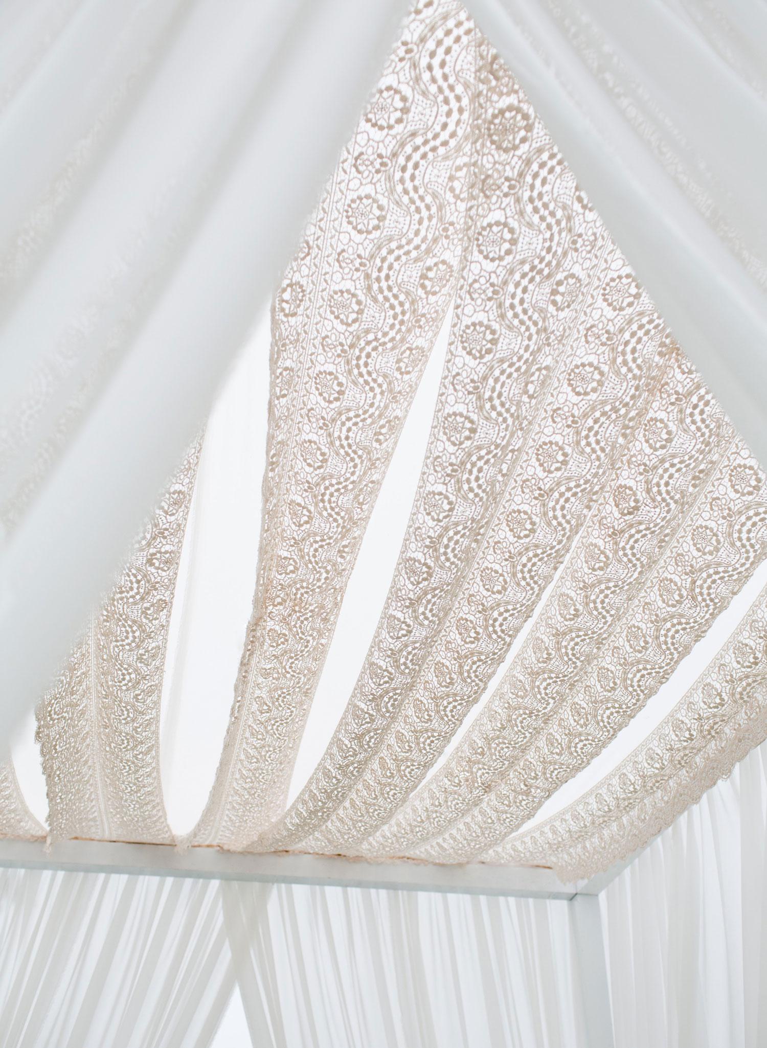 Lace chuppah ceremony canopy fabric drapery at wedding ceremony outdoor