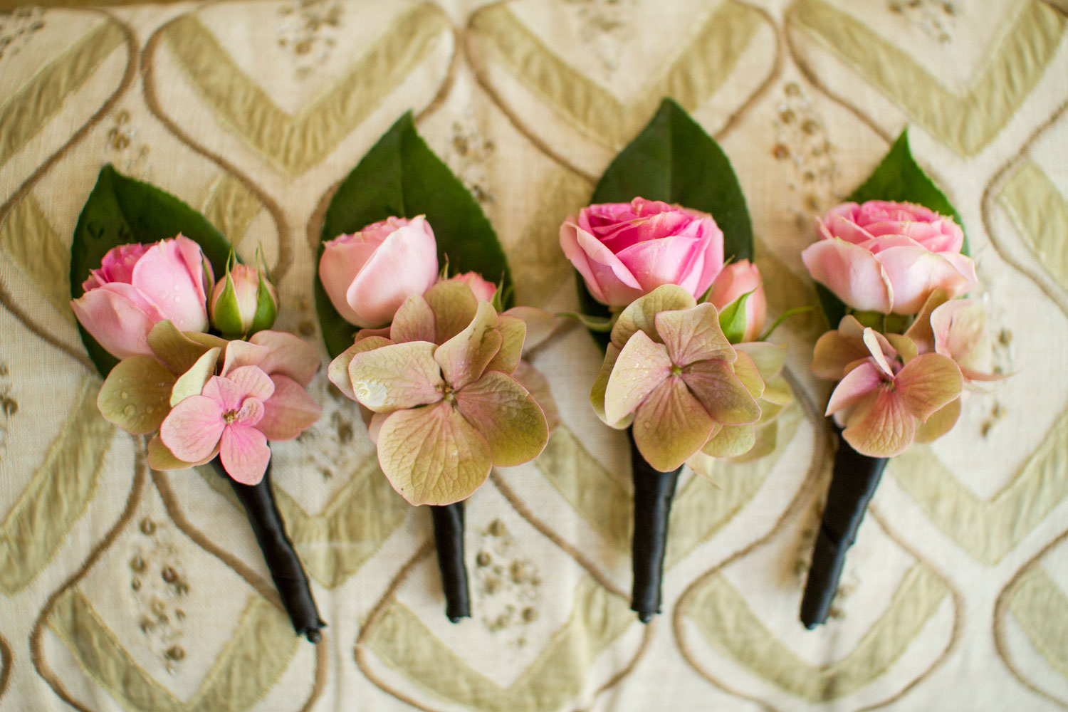 Pink boutonnieres for groom and groomsmen spring wedding ideas
