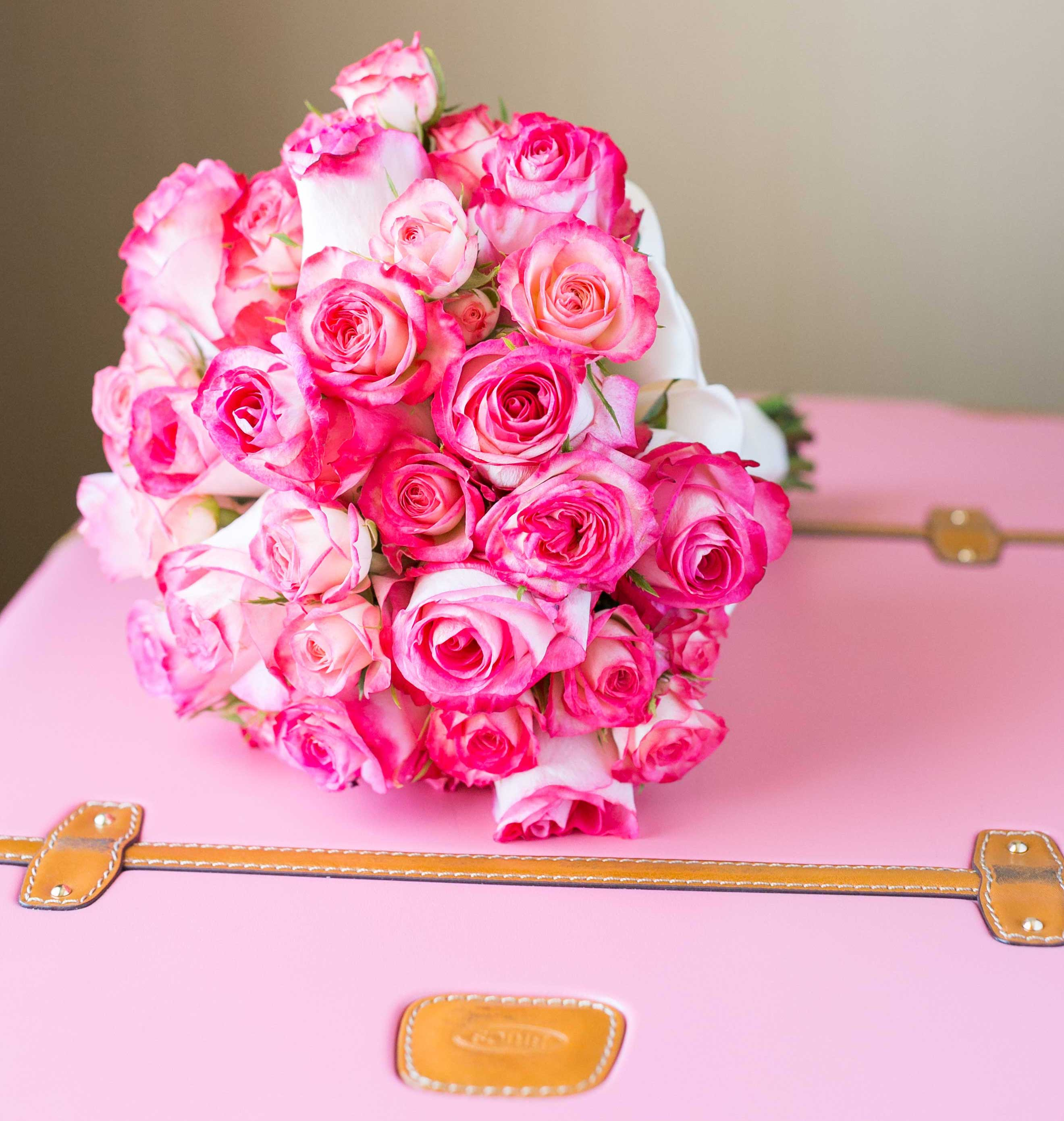 Pink rose bouquet on pink luggage wedding ideas