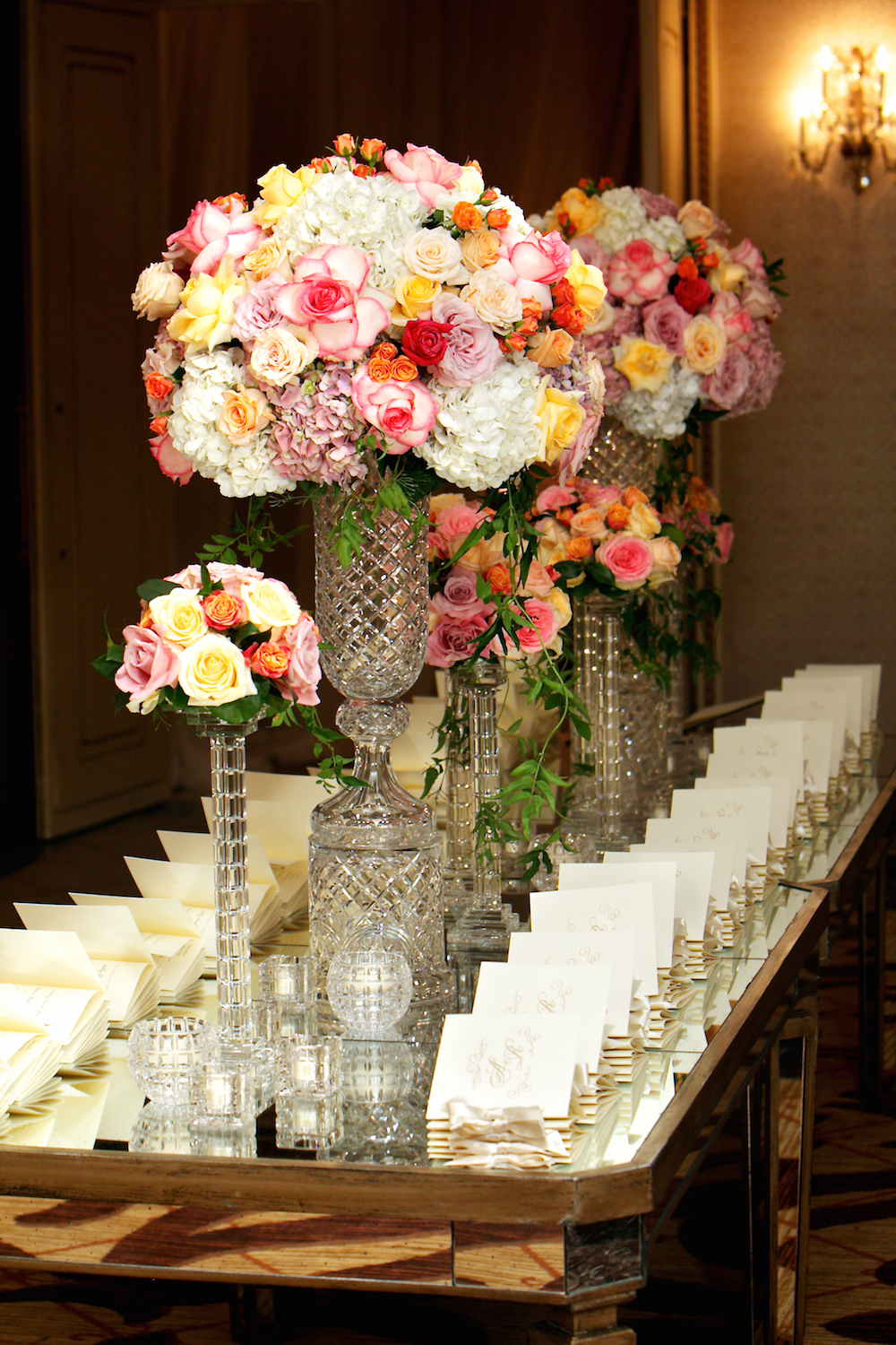 Pink rose flowers in flower arrangement on escort card table