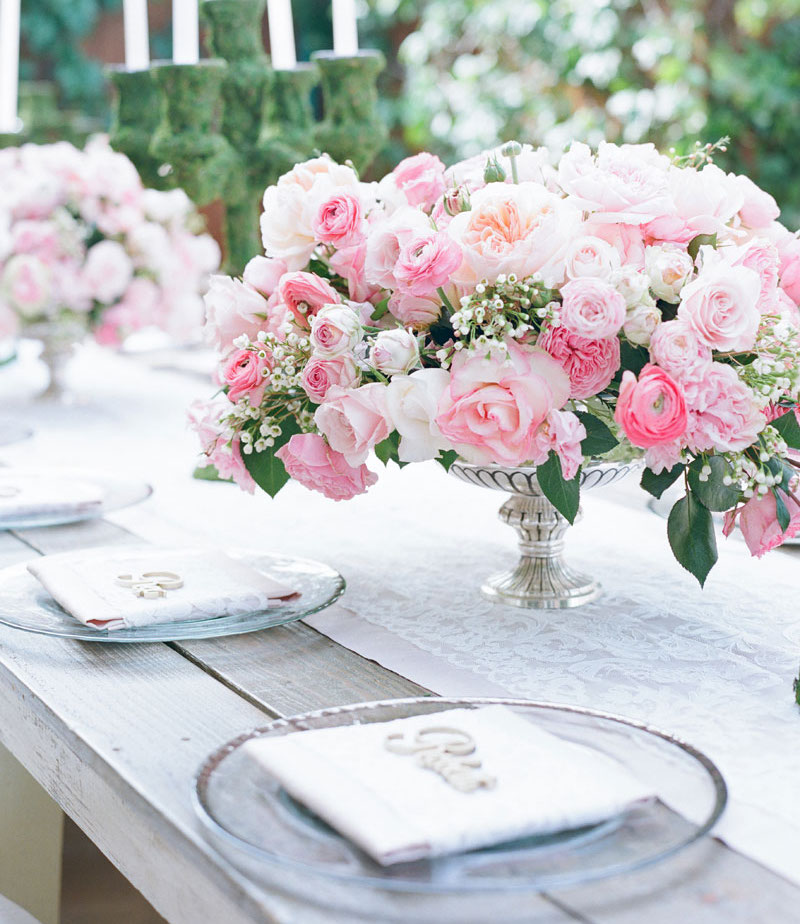 Wedding ideas decorating with pink rose flowers inside weddings pink rose flower arrangement low on outdoor wedding reception table mightylinksfo Gallery