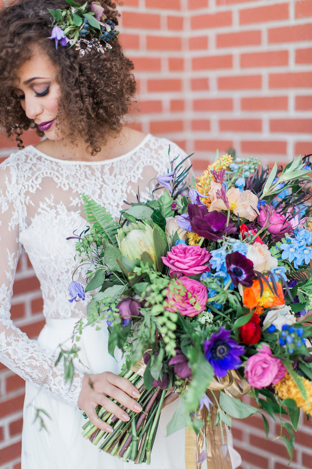 oversized multi-colored rainbow bridal bouquet with blue, pink, yellow, purple flowers